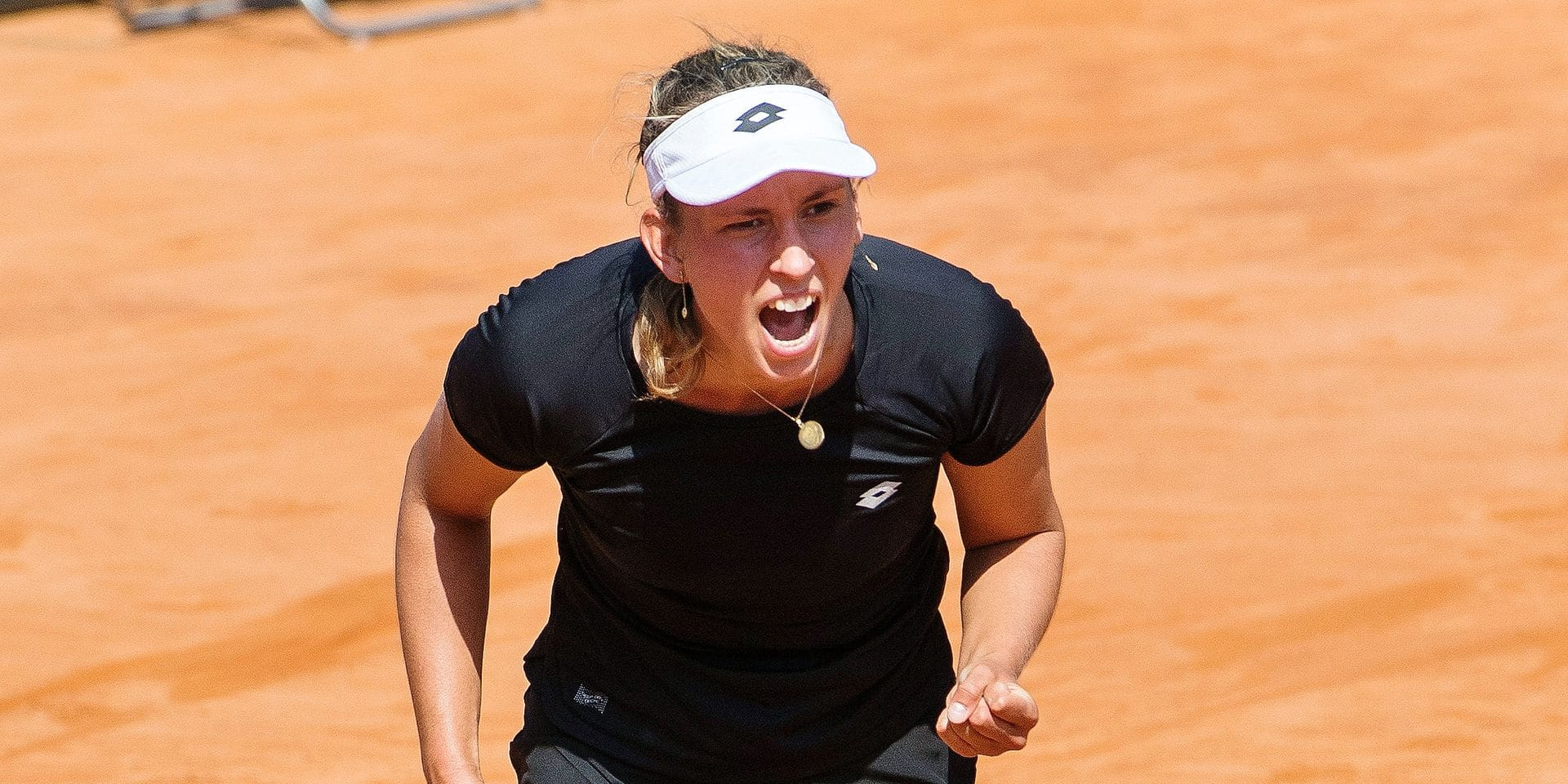 Belgian Elise Mertens celebrates during a tennis game between Italian Jasmine Paolini (WTA 145) and Belgian Elise Mertens (WTA 17), the first rubber of this weekend's Fed Cup World Group Play Off meeting between Italy and Belgium in Genoa, Italy, Saturday 21 April 2018. BELGA PHOTO LAURIE DIEFFEMBACQ