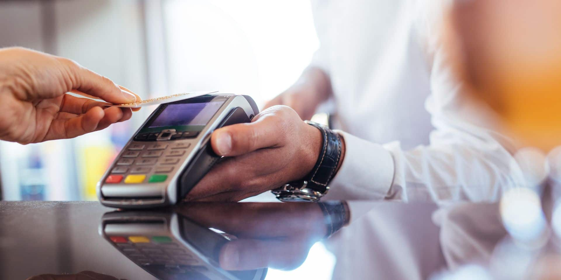 Hand,Of,Customer,Paying,With,Contactless,Credit,Card,With,Nfc