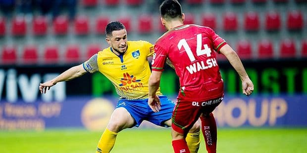 Union's Kevin Kis and Essevee's Sandy Walsh fight for the ball during a soccer game between SV Zulte Waregem and Royale Union Saint Gilloise, Friday 17 May 2019 in Waregem, on the tenth and last day of the Play-off 2B of the 'Jupiler Pro League' Belgian soccer championship. BELGA PHOTO JASPER JACOBS