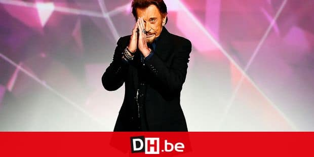 (FILES) In this file photo taken on February 13, 2016 French singer Johnny Hallyday gestures as he receives the best album award on stage during the 31st Victoires de la Musique, the annual French music awards ceremony, at the Zenith concert hall in Paris. - France will mark the first anniversary of Johnny Hallyday's death on December 5, 2018. French music icon Johnny Hallyday died on December 5, 2017 aged 74 after a battle with lung cancer plunging the country into mourning for a national treasure whose soft rock lit up the lives of three generations. (Photo by BERTRAND GUAY / AFP)
