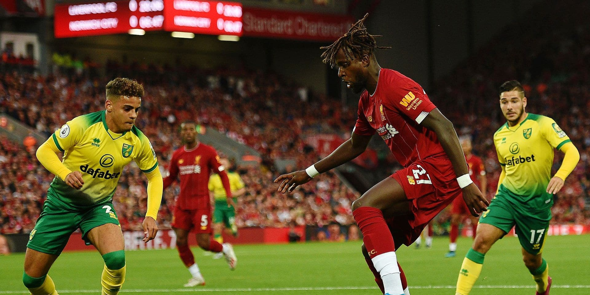Liverpool's Belgium striker Divock Origi (C) controls the ball during the English Premier League football match between Liverpool and Norwich City at Anfield in Liverpool, north west England on August 9, 2019. (Photo by Oli SCARFF / AFP) / RESTRICTED TO EDITORIAL USE. No use with unauthorized audio, video, data, fixture lists, club/league logos or 'live' services. Online in-match use limited to 120 images. An additional 40 images may be used in extra time. No video emulation. Social media in-match use limited to 120 images. An additional 40 images may be used in extra time. No use in betting publications, games or single club/league/player publications. /