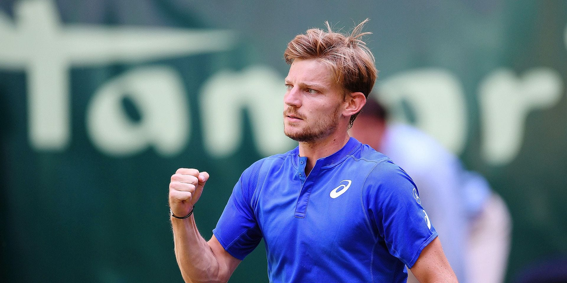 David Goffin from Belgium reacts during his match against Alexander Zverev from Germany at the ATP tennis tournament in Halle, western Germany, on June 21, 2019. (Photo by CARMEN JASPERSEN / AFP)