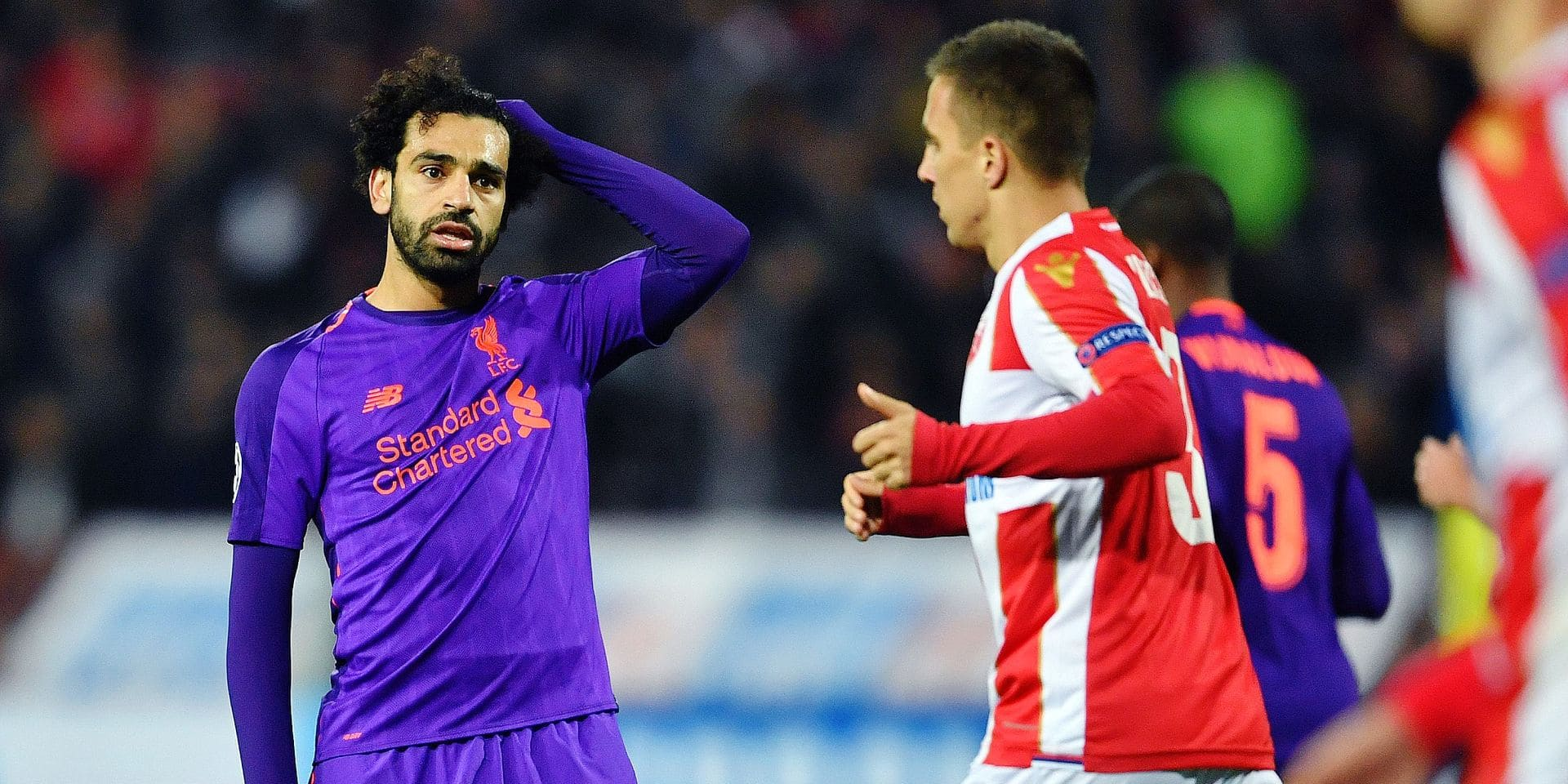 Liverpool's Egyptian forward Mohamed Salah (L) reacts during the UEFA Champions League Group C second-leg football match between Red Star Belgrade and Liverpool FC at the Rajko Mitic Stadium in Belgrade on November 6, 2018. (Photo by Andrej ISAKOVIC / AFP)