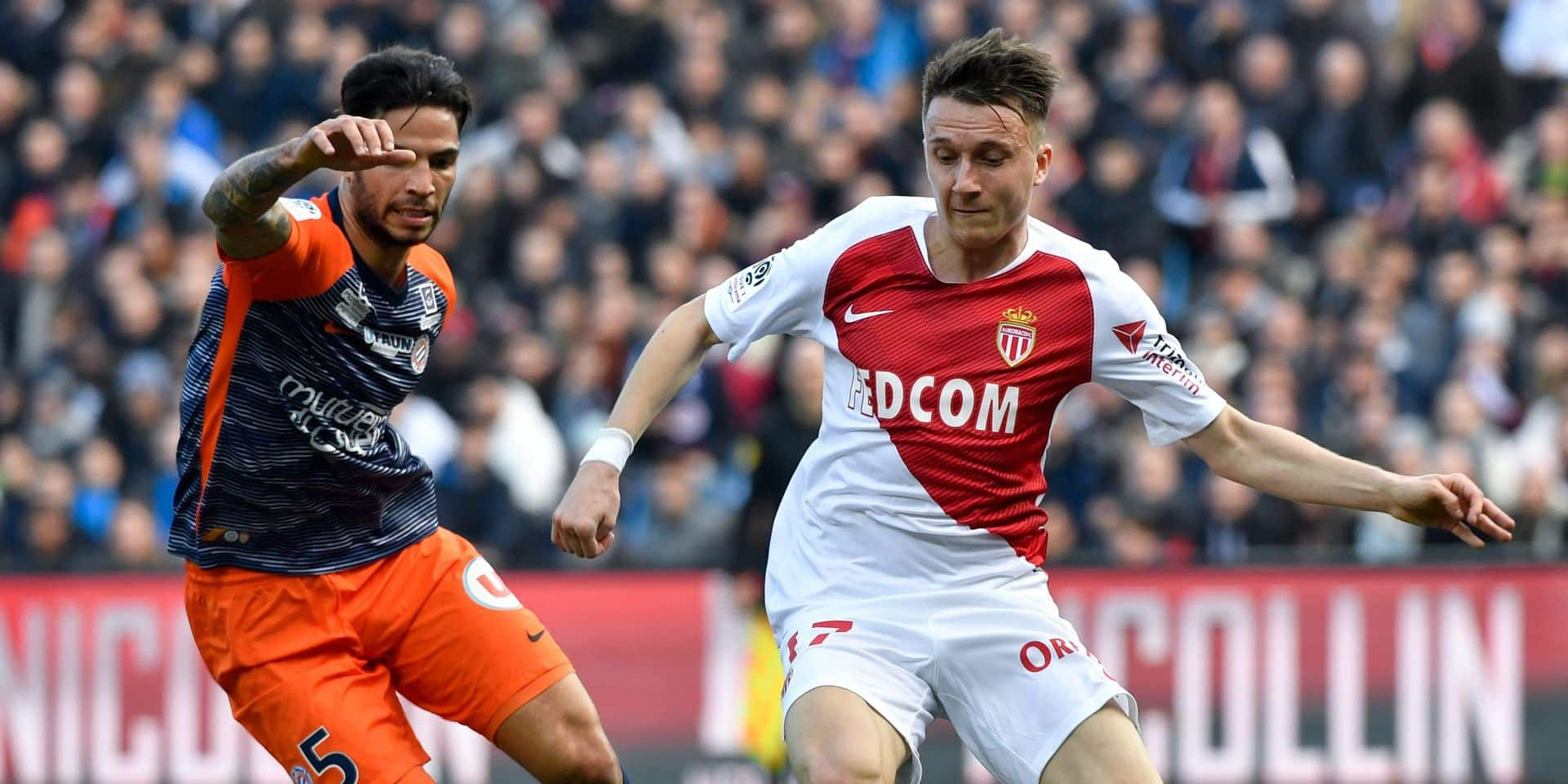 (FILES) In this file photo taken on February 10, 2019 Montpellier's Portuguese defender Pedro Mendes (L) fights for the ball with Monaco's Russian midfielder Aleksandr Golovin (R) during the French L1 football match between Montpellier Herault SC and AS Monaco at the Mosson stadium in Montpellier, southern France. (Photo by GERARD JULIEN / AFP)