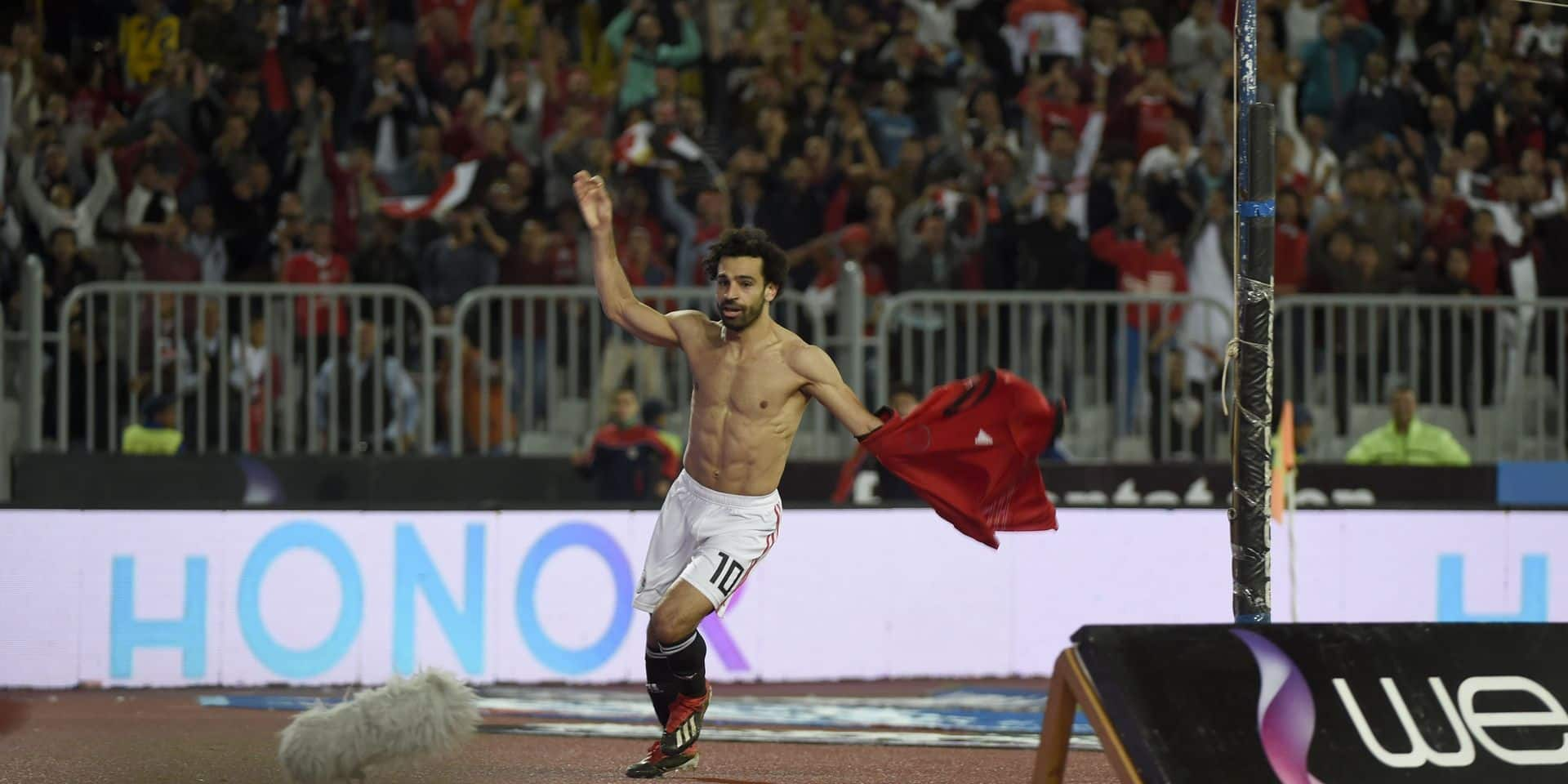 Egypt's forward Mohamed Salah (L) celebrates after scoring a goal during the Africa Cup of Nations qualifier football match Egypt vs Tunisia at the Borg El Arab Stadium, near Alexandria, on November 16, 2018. (Photo by KHALED DESOUKI / AFP)