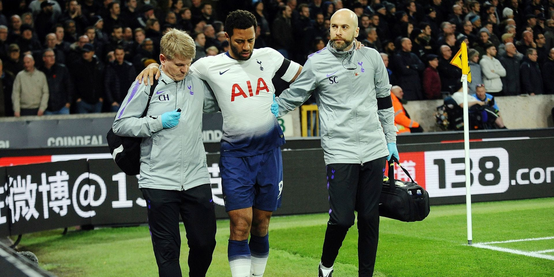 Medics help Tottenham's Mousa Dembele, center, to leave the field during the English Premier League soccer match between Wolverhampton Wanderers and Tottenham Hotspur at the Molineux Stadium in Wolverhampton, England, Saturday, Nov. 3, 2018. (AP Photo/Rui Vieira)