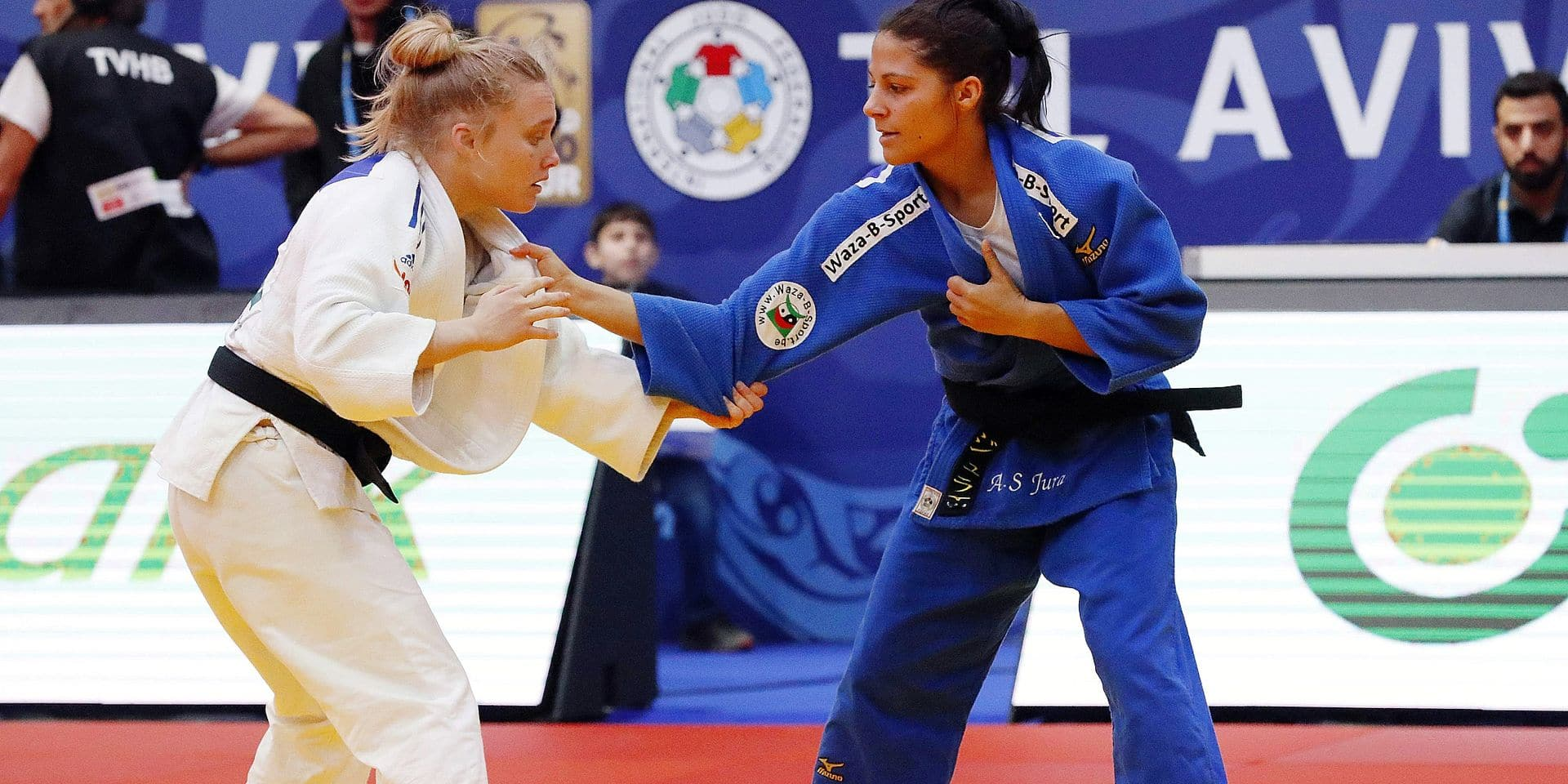 Israel's Tamar Malca (white) competes against Belgium's Anne-Sophie Jura during their women's under 48kg match at the the Tel Aviv Grand Prix 2019 on January 24, 2019, in the Israeli coastal city. (Photo by JACK GUEZ / AFP)