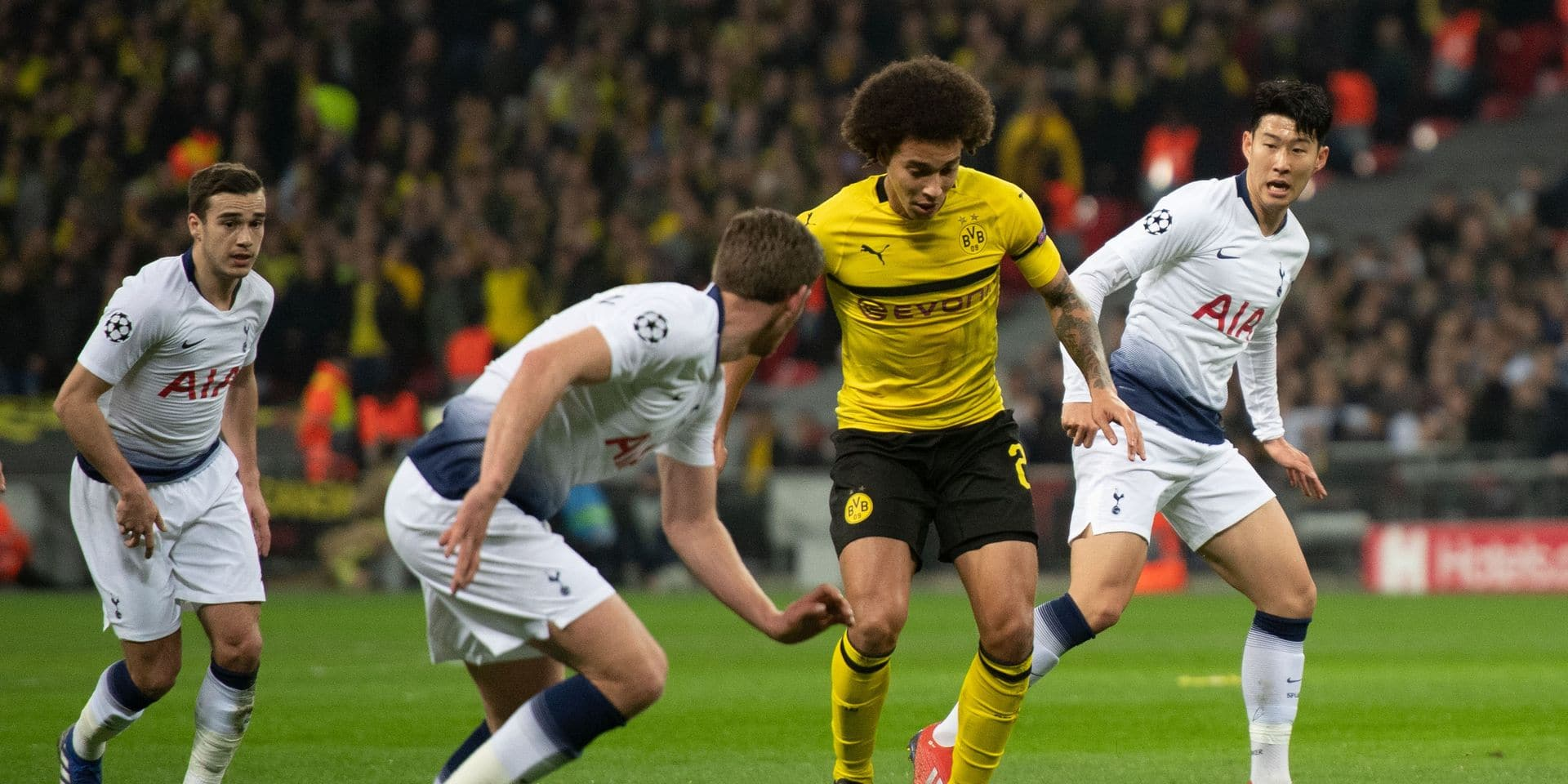 13 February 2019, Great Britain, London: Soccer: Champions League, Tottenham Hotspur - Borussia Dortmund, knockout round, round of sixteen, first legs at Wembley Stadium: Axel Witsel (2nd from right) and Jan Vertonghen (2nd from left) and Heung-Min Son (r) from Tottenham try to get the ball. Photo: Bernd Thissen/dpa Reporters / DPA