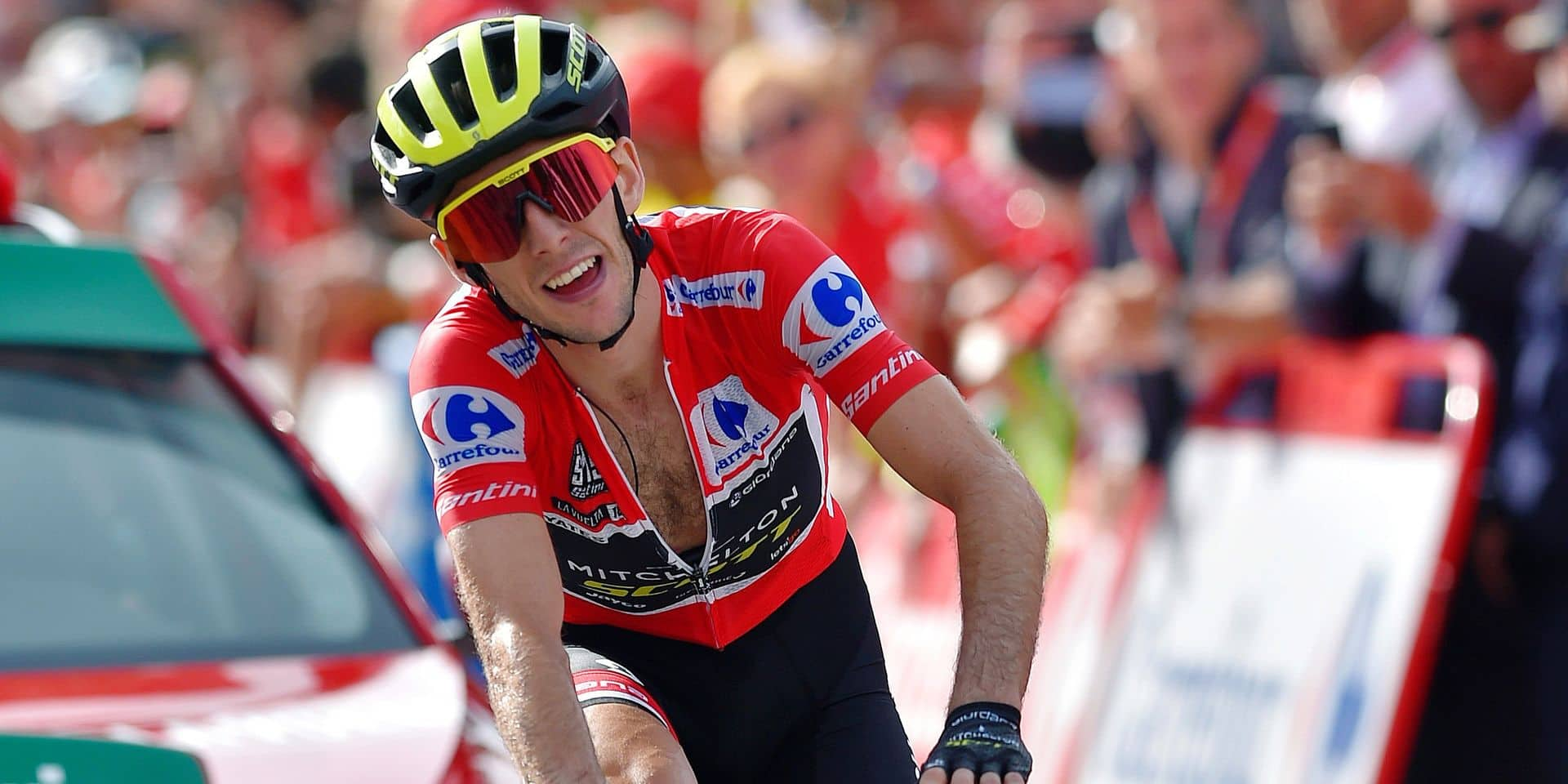"Mitchelton-Scott's British cyclist Simon Philip Yates crosses the finish line of the 19th stage of the 73rd edition of ""La Vuelta"" Tour of Spain cycling race, a 154.4 km flat route from Lleida to La Rabassa in Andorra, on September 14, 2018. (Photo by ANDER GILLENEA / AFP)"