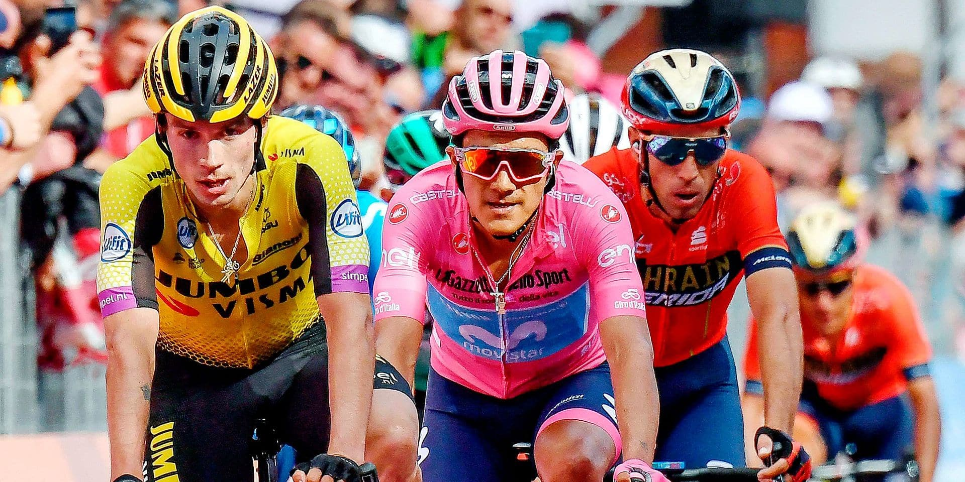From left, Slovenia's Primoz Roglic, Ecuador's Richard Antonio Carapaz Montenegro, and Italy's Vincenzo Nibali, cross the finish line at the end of the 19th stage of the Giro d'Italia cycling race, from Treviso to San Marino di Castrozza, Italy, Friday, May 31, 2019. (Alessandro Di Meo/ANSA via AP)