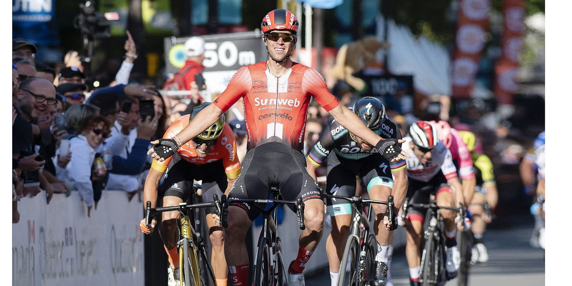 Michael Matthews, of Australia, raises his arms as he wins the Grand Prix Cycliste de Quebec, in Quebec City, Friday, Sept. 13, 2019. Matthews is flanked by third-place Greg Van Avermaet, left, of Belgium, and second-place Peter Sagan, of Slovakia. (Jacques Boissinot/The Canadian Press via AP)