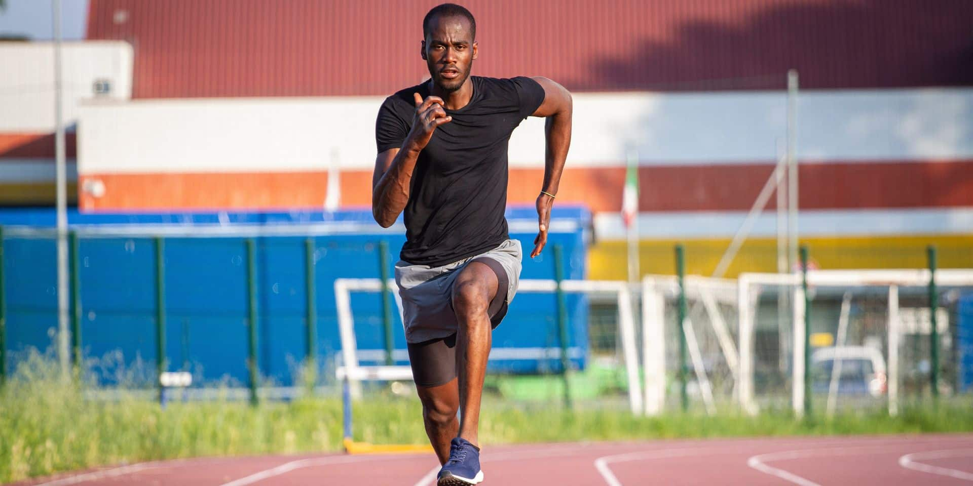 Portrait,Of,Young,African,Male,Athlete,Is,Running,On,Race