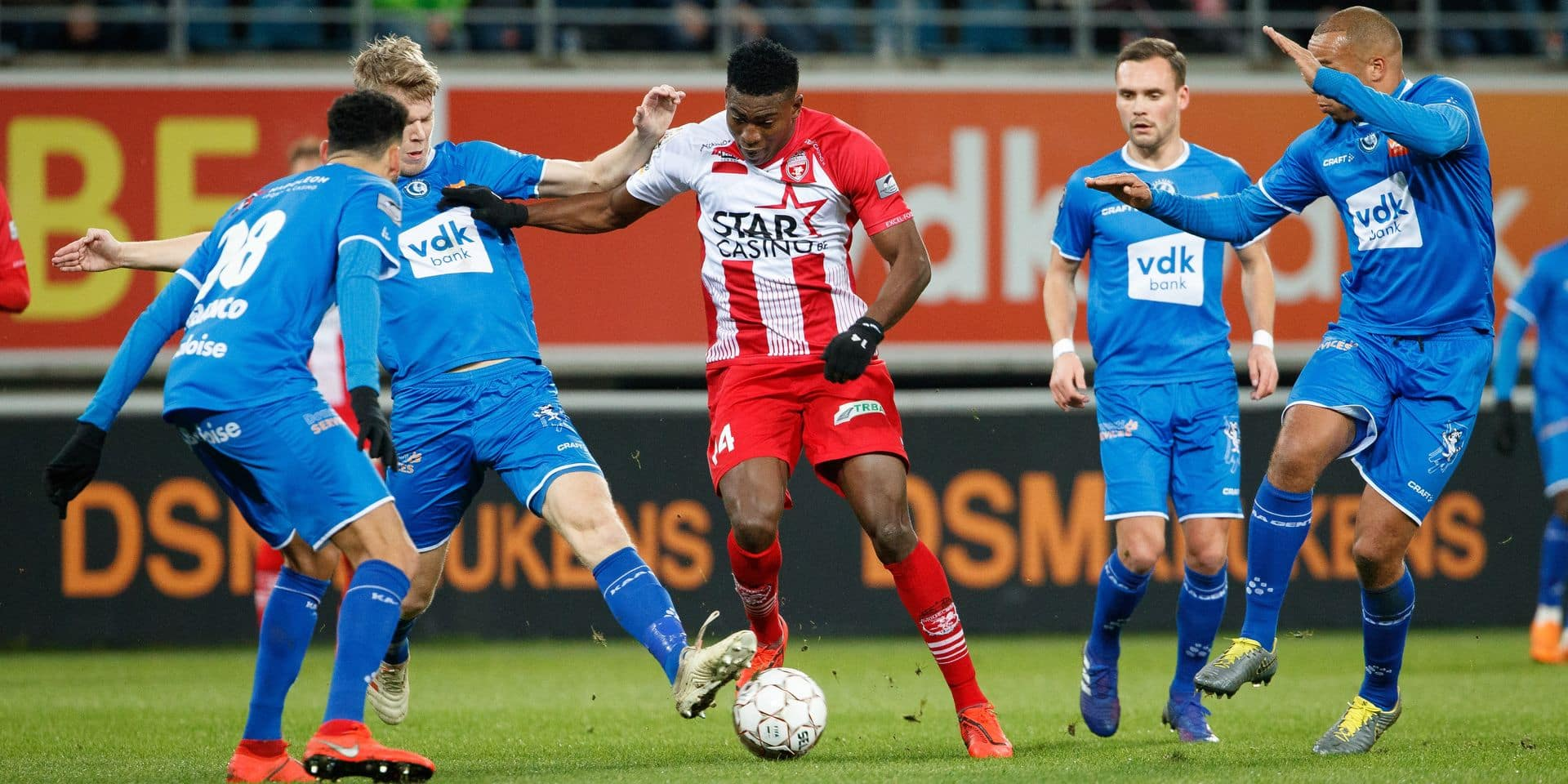 Gent's Sigurd Rosted and Mouscron's Taiwo Awoniyi fight for the ball during a soccer match between KAA Gent and Royal Excel Mouscron, Sunday 10 February 2019 in Gent, on day 25th of the 'Jupiler Pro League' Belgian soccer championship season 2018-2019. BELGA PHOTO KURT DESPLENTER