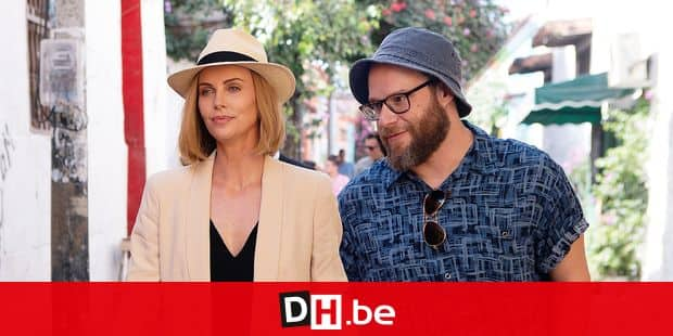 "This image released by Lionsgate shows Charlize Theron, left, and Seth Rogen in a scene from ""Long Shot."" (Hector Alvarez/Lionsgate via AP)"