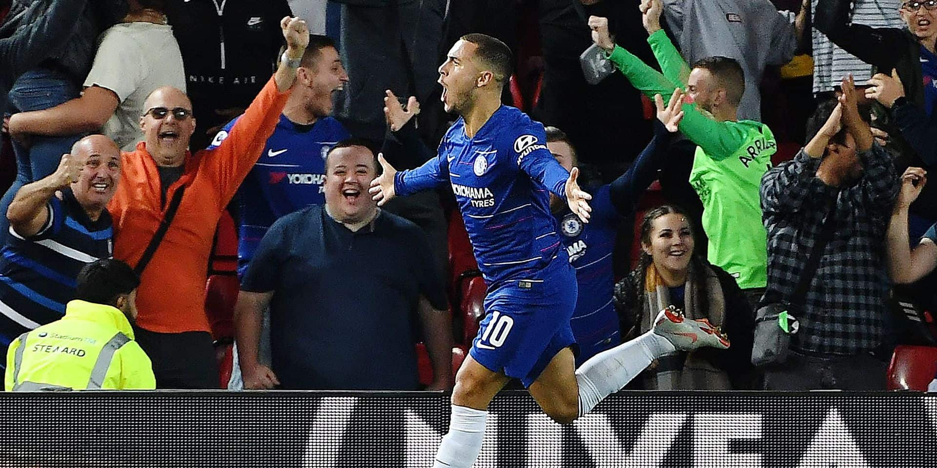 Chelsea's Belgian midfielder Eden Hazard celebrates scoring his team's second goal during the English League Cup third round football match between Liverpool and Chelsea at Anfield in Liverpool, north west England on September 26, 2018. (Photo by Paul ELLIS / AFP) / RESTRICTED TO EDITORIAL USE. No use with unauthorized audio, video, data, fixture lists, club/league logos or 'live' services. Online in-match use limited to 120 images. An additional 40 images may be used in extra time. No video emulation. Social media in-match use limited to 120 images. An additional 40 images may be used in extra time. No use in betting publications, games or single club/league/player publications. /