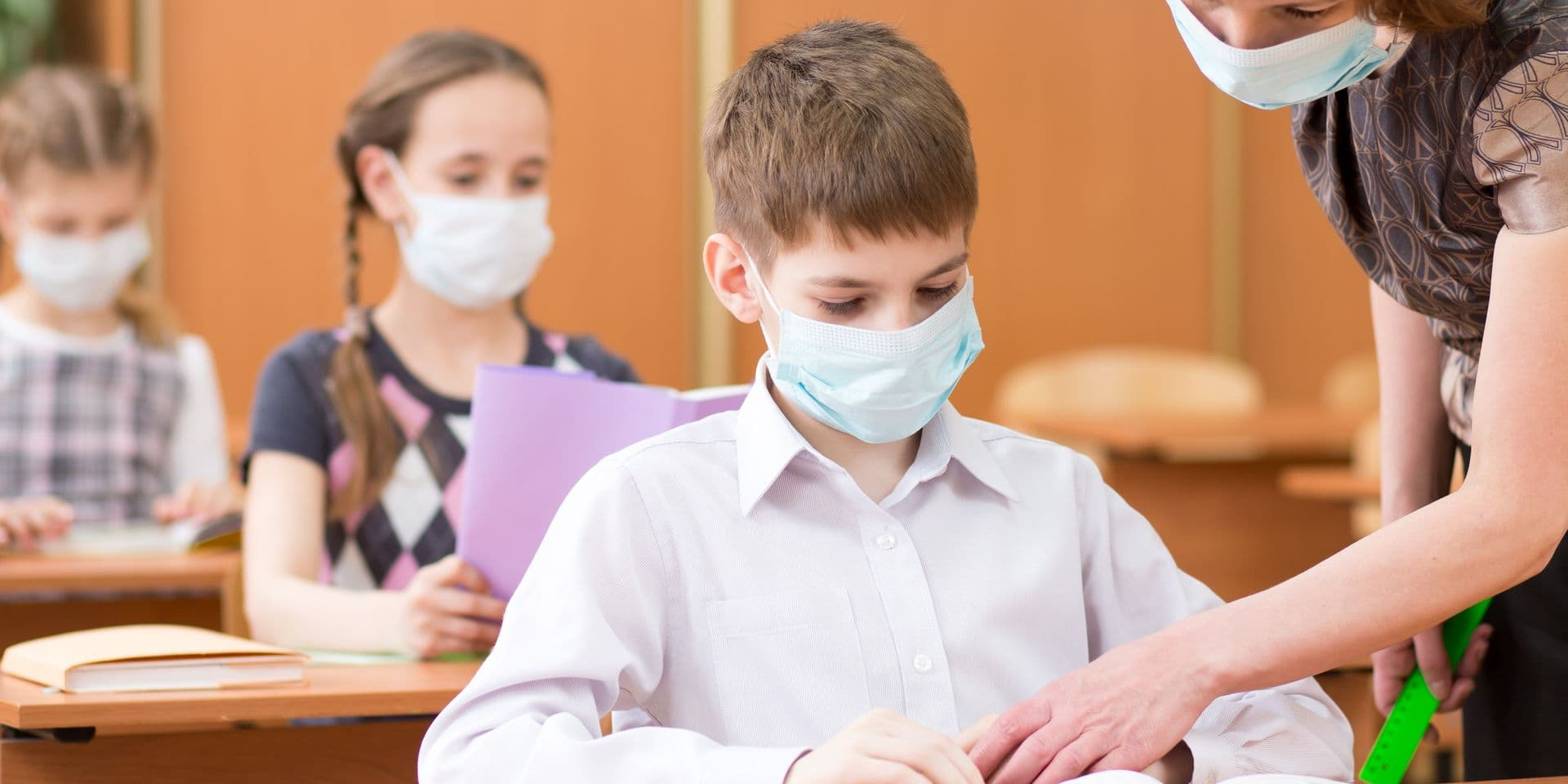 School,Children,With,Protective,Masks,Against,Coronavirus,At,Lesson,In