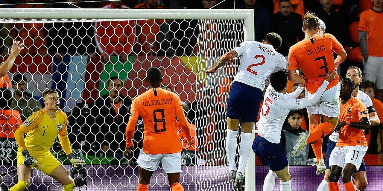 Netherlands' Matthijs de Ligt, top right, scores his side's opening goal during the UEFA Nations League semifinal soccer match between Netherlands and England at the D. Afonso Henriques stadium in Guimaraes, Portugal, Thursday, June 6, 2019. (AP Photo/Martin Meissner)