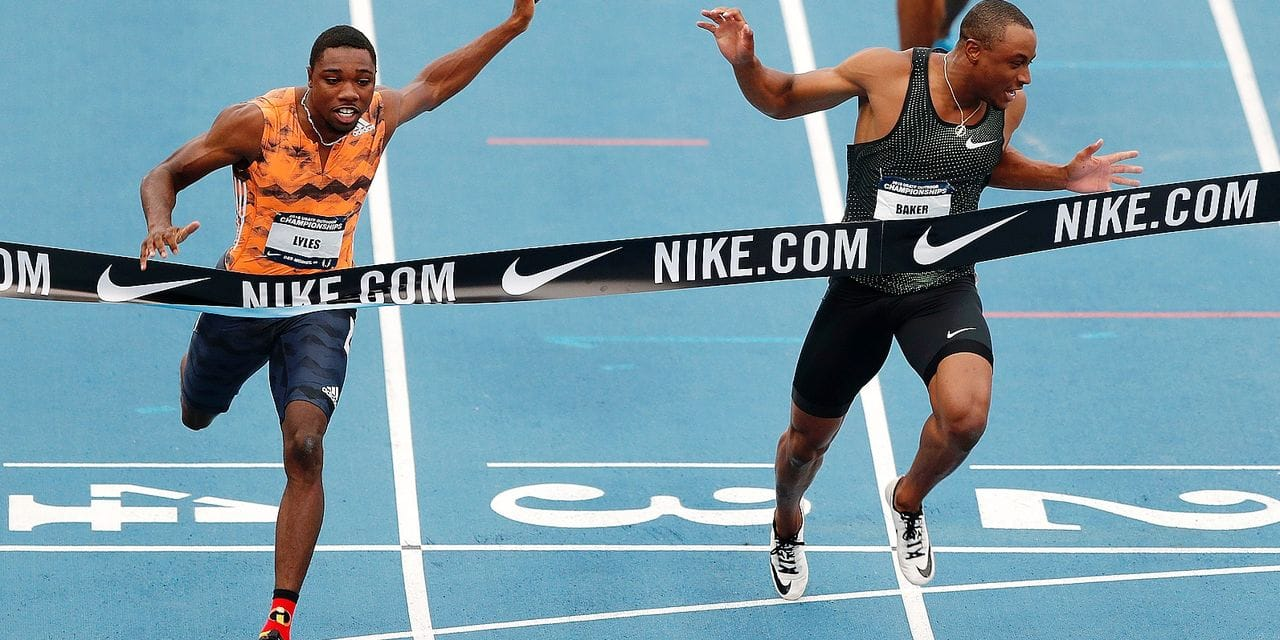 Noah Lyles beats Ronnie Baker, right, to the finish line while winning the men's 100 meters the U.S. Championships athletics meet Friday, June 22, 2018, in Des Moines, Iowa. (AP Photo/Charlie Neibergall)