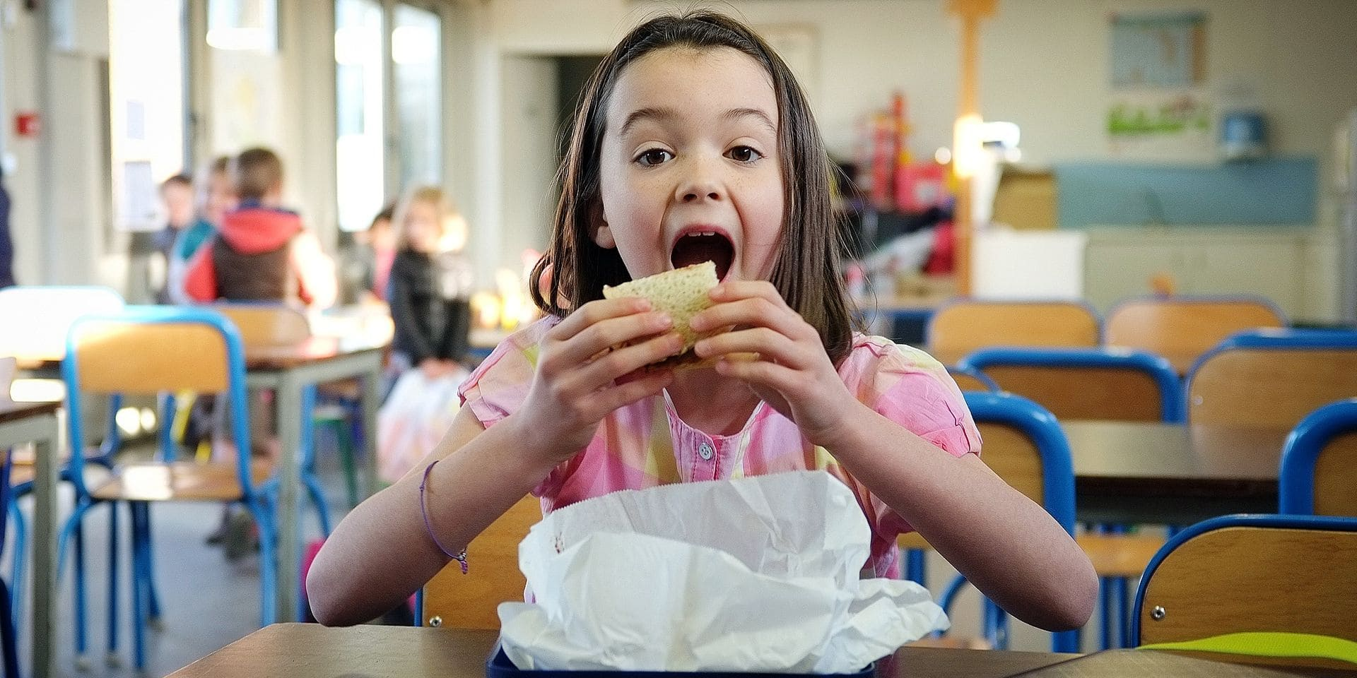 MODEL RELEASE 20150419 - BRUSSELS, BELGIUM: Illustration picture shows a girl eating bread from her lunch box at school, Sunday 19 April 2015 in Namur. BELGA PHOTO BRUNO FAHY