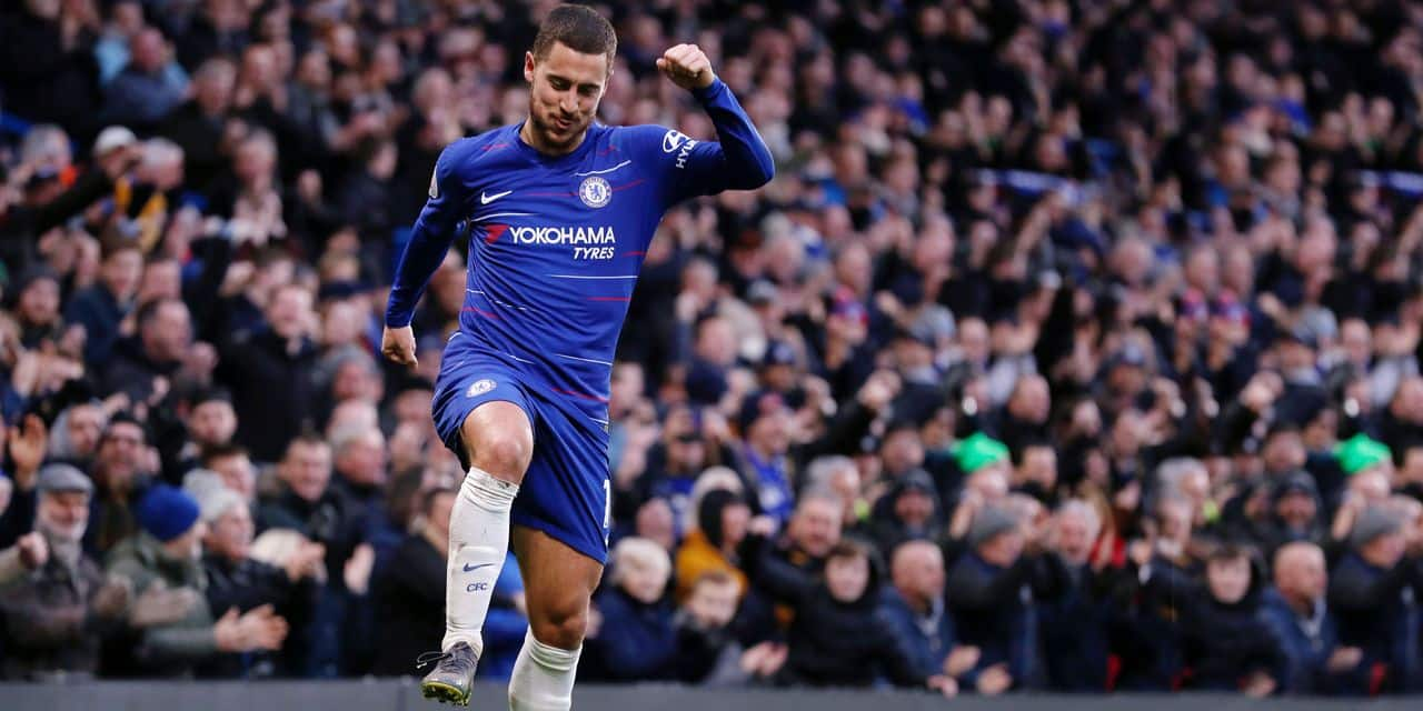 Chelsea's Eden Hazard celebrates after scoring his side's third goal during the English Premier League soccer match between Chelsea and Huddersfield Town at Stamford Bridge stadium in London, Britain, Saturday, Feb. 2, 2019. (AP Photo/ Alastair Grant)