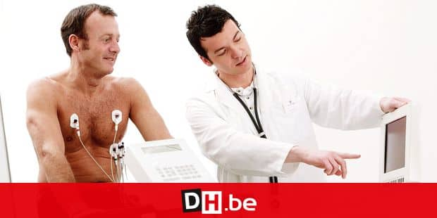 MODEL RELEASED. Heart fitness test. Doctor showing test results to a patient riding an exercise bike during an assessment of his cardiovascular system. The patient is fitted with electrodes (round), which monitor the electrical activity of his beating heart. This test is used to diagnose arrhythmia (irregular heartbeat), and some forms of coronary artery disease.