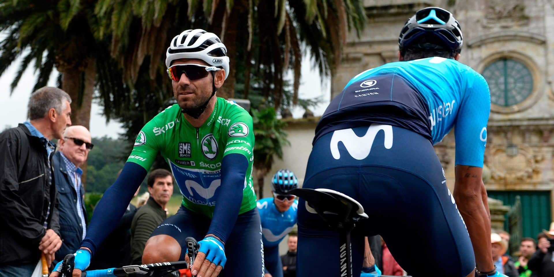 """Movistar's Spanish cyclist Alejandro Valverde (L) arrives for the start of the 12th stage of the 73rd edition of """"La Vuelta"""" Tour of Spain cycling race, a 181.1km route from Mondonedo to Mañon, on September 6, 2018. (Photo by MIGUEL RIOPA / AFP)"""