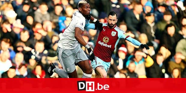 Manchester United's Paul Pogba, left, and Burnley's Steven Defour battle for the ball during their English Premier League soccer match at Turf Moor, Burnley, England, Saturday, Jan. 20, 2018. (Dave Thompson/PA via AP)