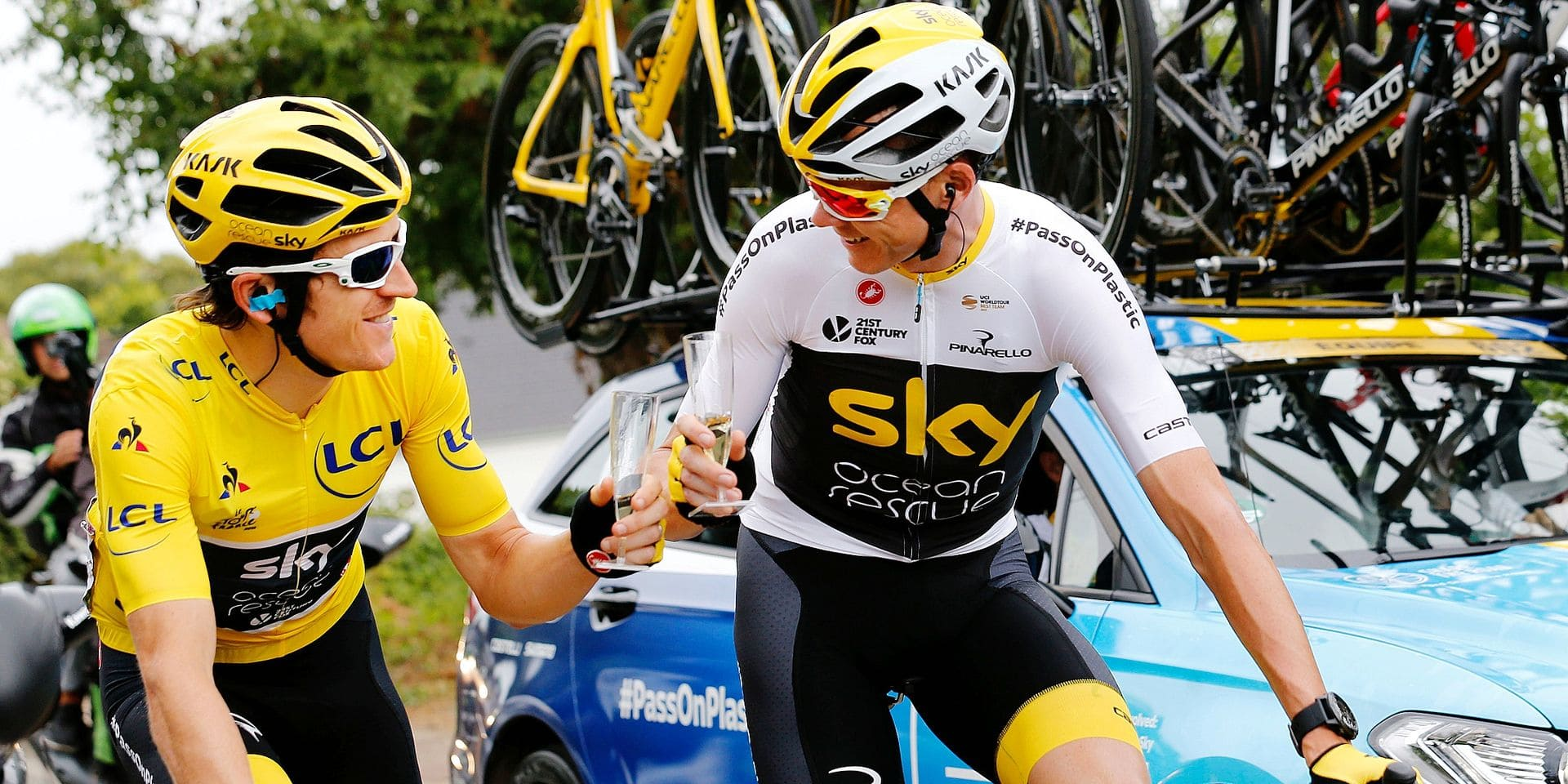 British Geraint Thomas of Team Sky and British Chris Froome of Team Sky pictured with champagne during the last stage of the 105th edition of the Tour de France cycling race, 116km from Houilles to Paris, France, Sunday 29 July 2018. This year's Tour de France takes place from July 7th to July 29th. BELGA PHOTO YUZURU SUNADA