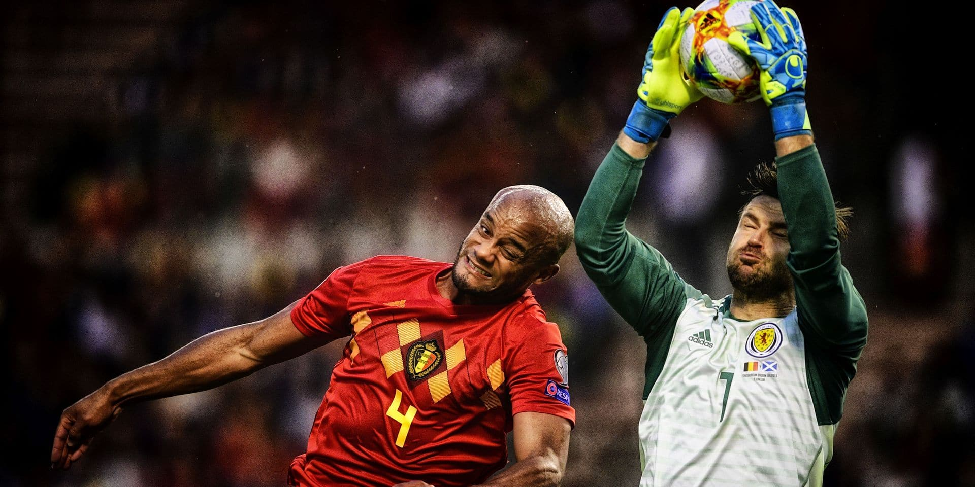 Belgium's Vincent Kompany and Scotland's goalkeeper David Marshall fight for the ball during a soccer game between Belgian national team the Red Devils and Scotland, Tuesday 11 June 2019 in Brussels, an UEFA Euro 2020 qualification game. BELGA PHOTO YORICK JANSENS