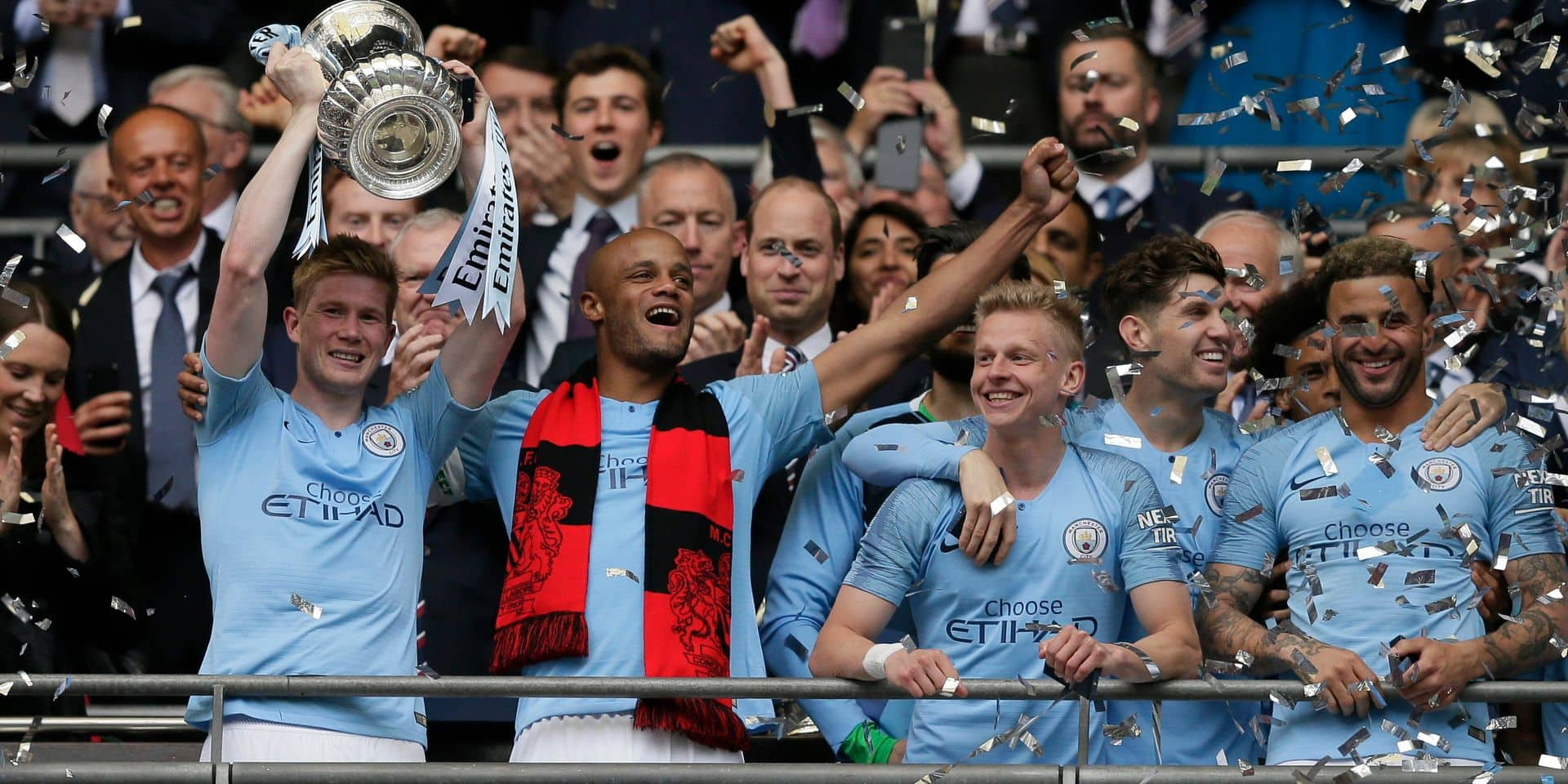 Manchester City's Kevin De Bruyne lifts the trophy after winning the English FA Cup Final soccer match between Manchester City and Watford at Wembley stadium in London, Saturday, May 18, 2019. Manchester City won 6-0. (AP Photo/Tim Ireland)