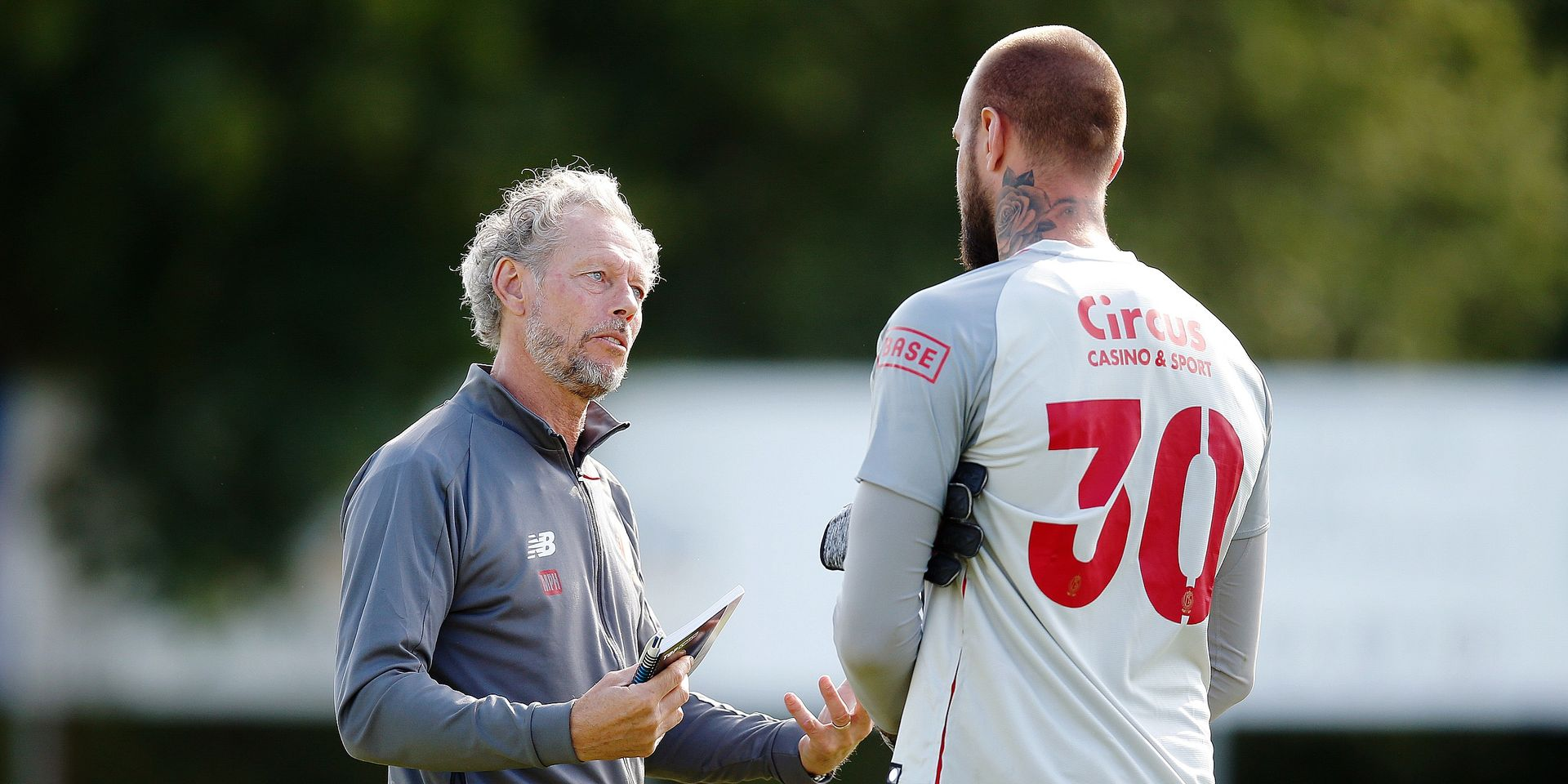 Standard's head coach Michel Preud'homme and Standard's Vanja Milincovic Savic pictured after a friendly game against Denmark's Sonderjysk, part of the summer stage of Belgian soccer team Standard de Liege, Wednesday 03 July 2019 in Rheine, Germany, in preparation of the upcoming 2019-2020 Jupiler Pro League season. BELGA PHOTO BRUNO FAHY