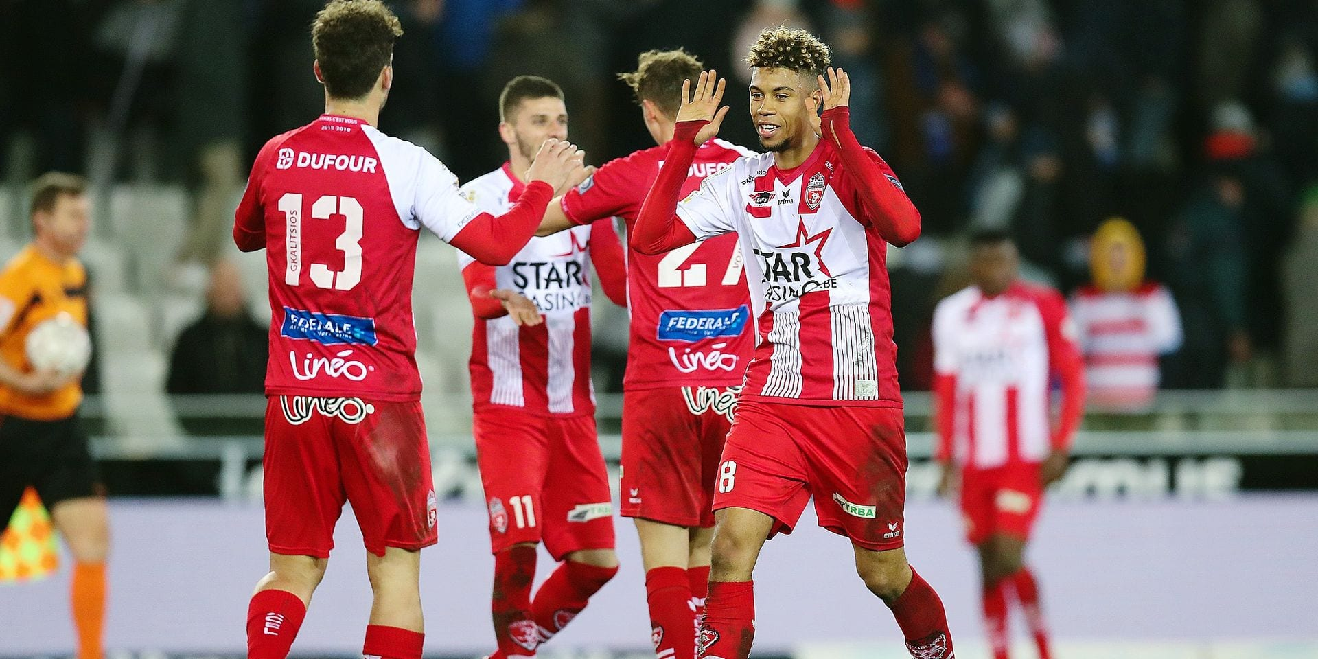 Mouscron's players celebrate after winning a soccer game between Club Brugge KV and Royal Excel Mouscron, Sunday 17 March 2019 in Brugge, on the 30th day of the 'Jupiler Pro League' Belgian soccer championship season 2018-2019. BELGA PHOTO BRUNO FAHY