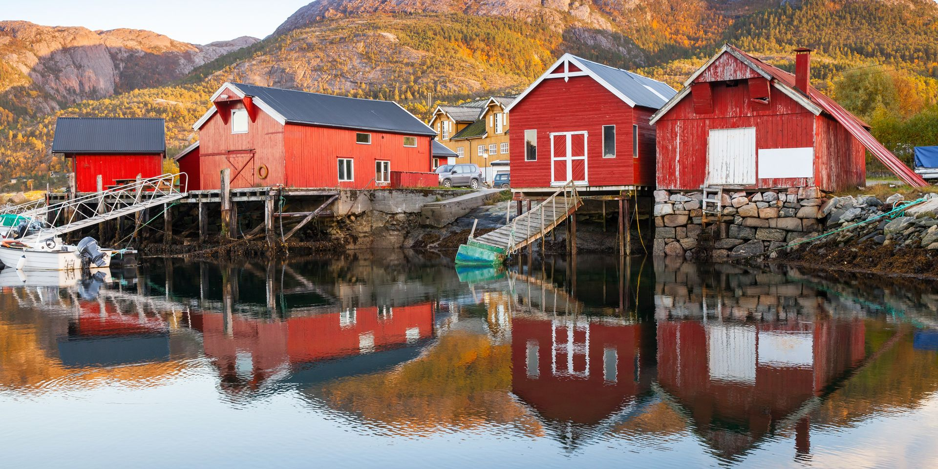 Traditional,Norwegian,Red,Wooden,Barns,Stand,On,The,Sea,Coast.