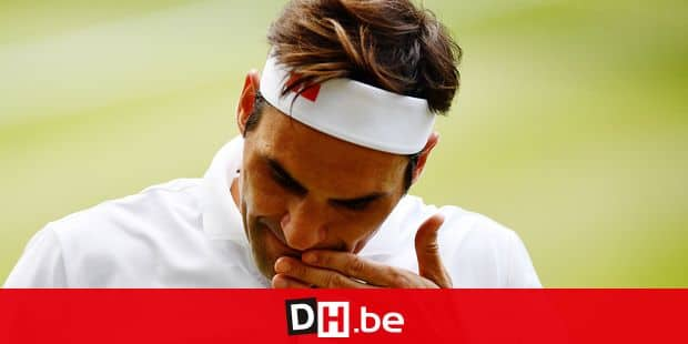 Switzerland's Roger Federer reacts after a point against Serbia's Novak Djokovic during the men's singles final on day thirteen of the 2019 Wimbledon Championships at The All England Lawn Tennis Club in Wimbledon, southwest London, on July 14, 2019. (Photo by Daniel LEAL-OLIVAS / AFP) / RESTRICTED TO EDITORIAL USE