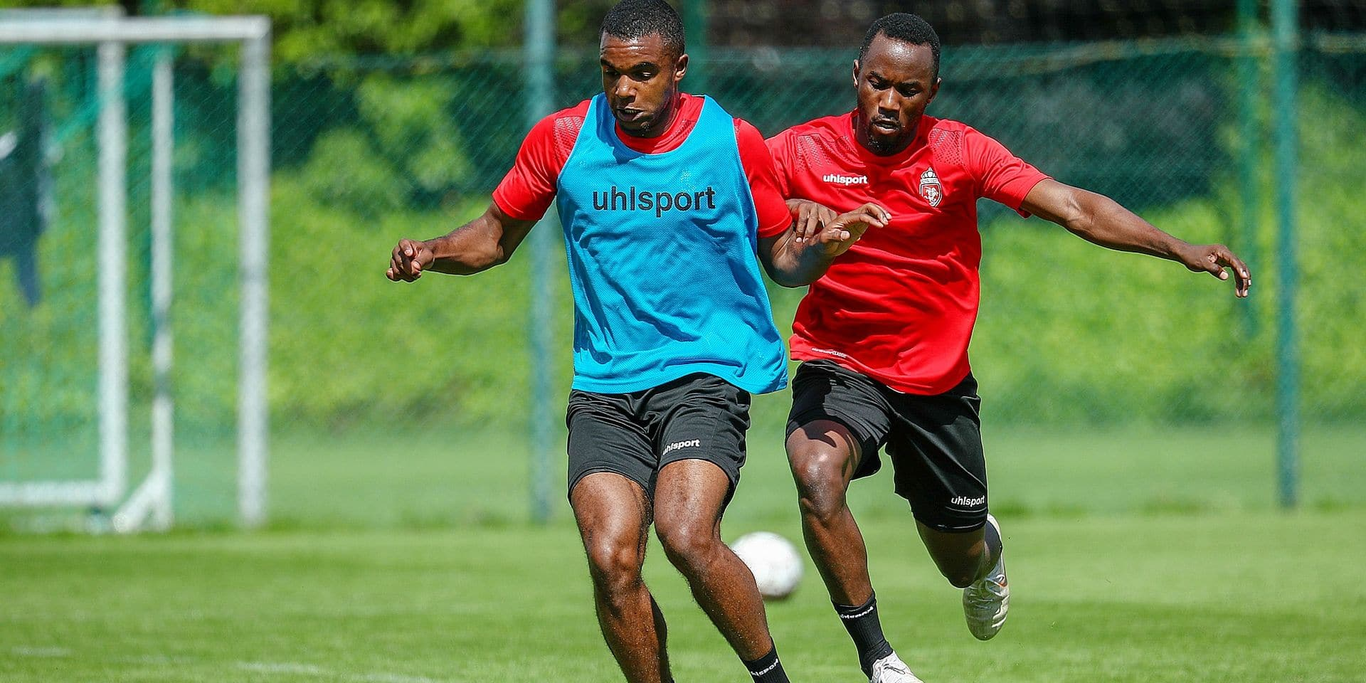 Mouscron's Nathan De Medina and Mouscron's Fabrice Olinga fight for the ball during a training session of Belgian soccer team Royal Excel Mouscron, Friday 21 June 2019 in Mouscron, in preparation of the upcoming 2019-2020 Jupiler Pro League season. BELGA PHOTO VIRGINIE LEFOUR