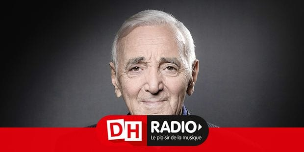 French-Armenian singer Charles Aznavour poses during a photo session in Paris on November 16, 2017. / AFP PHOTO / JOEL SAGET