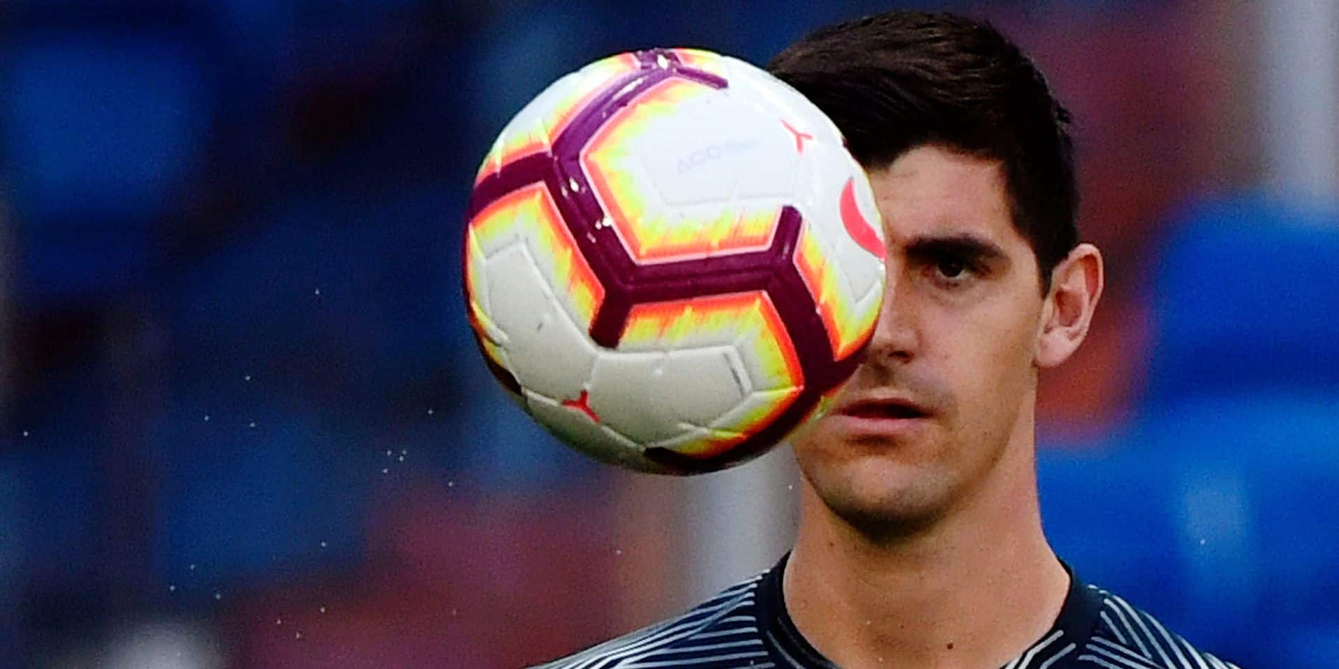 Real Madrid's Belgian goalkeeper Thibaut Courtois eyes the ball as he warms up before the Spanish league football match between Real Madrid CF and RC Celta de Vigo at the Santiago Bernabeu stadium in Madrid on March 16, 2019. (Photo by GABRIEL BOUYS / AFP)