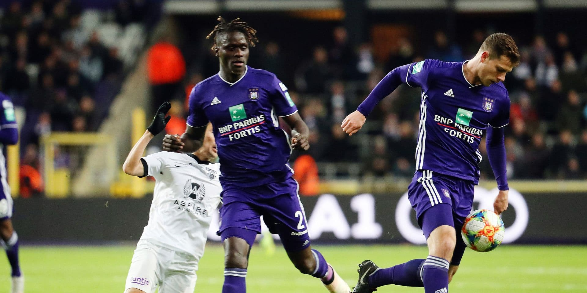 Eupen's Yuta Toyokawa, Anderlecht's Kara Mbodji and Anderlecht's James Lawrence fight for the ball during the soccer match between RSC Anderlecht and KAS Eupen, Sunday 27 January 2019 in Brussels, on the 23rd day of the 'Jupiler Pro League' Belgian soccer championship season 2018-2019. BELGA PHOTO VIRGINIE LEFOUR