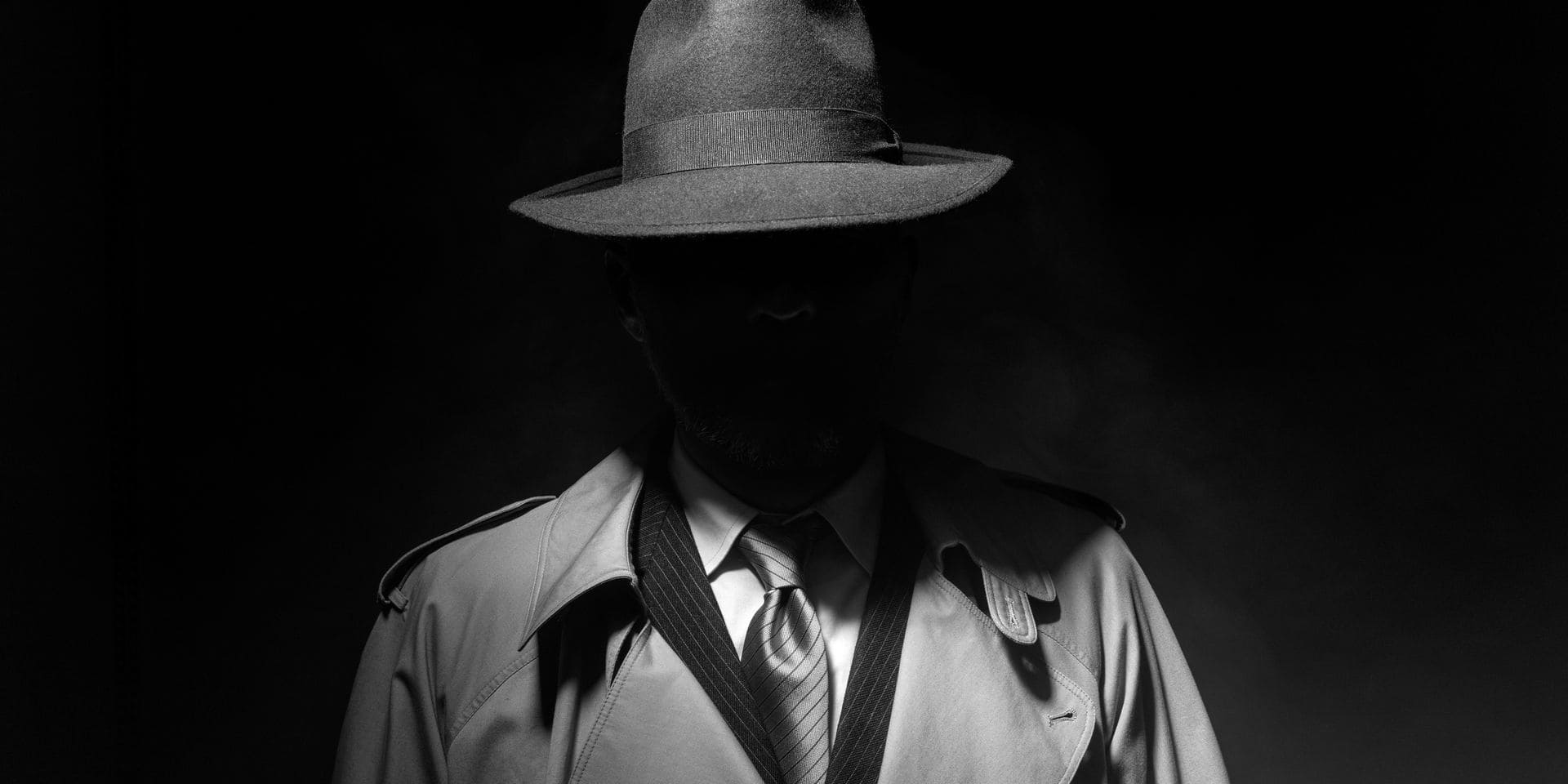 Man,Posing,In,The,Dark,With,A,Fedora,Hat,And