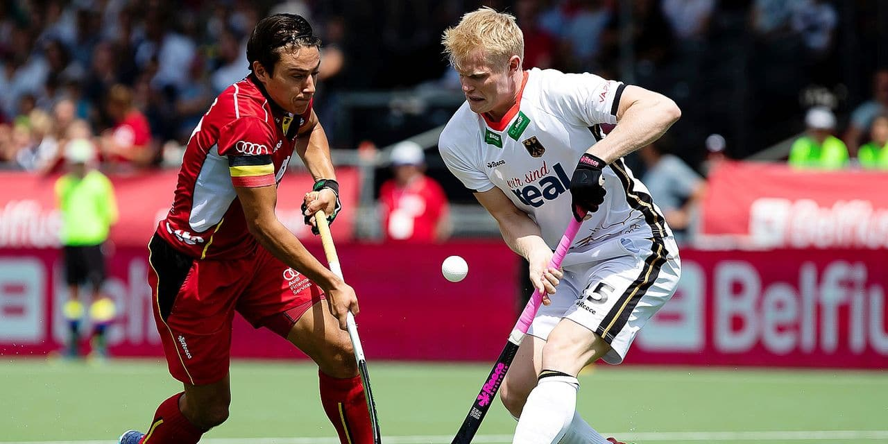 Belgium's captain Thomas Briels and Germany's Tom Grambusch fight for the ball during a field hockey game between Belgium's Red Lions and Germany, Sunday 02 June 2019 in Wilrijk, Antwerp, game 8/14 of the men's FIH Pro League competition. BELGA PHOTO KRISTOF VAN ACCOM