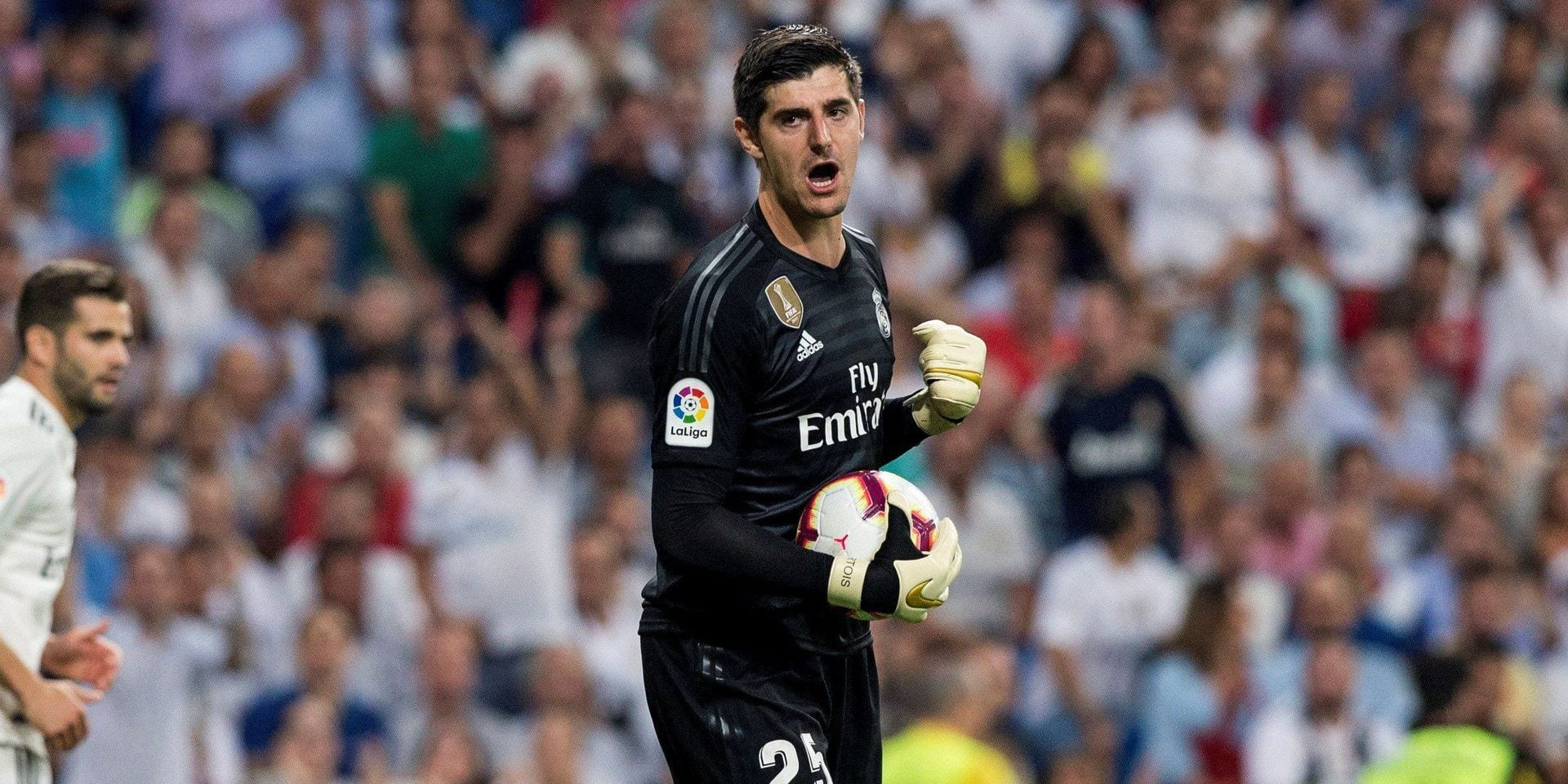 Real Madrid's goalkeeper Thibaut Courtois reacts during a game of La Liga Santander against Atletico de Madrid, at the Santiago Bernabeu Stadium in Madrid, Spain, 29 September 2018. EFE/Rodrigo Jimenez