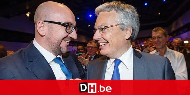 20141009 - BRUSSELS, BELGIUM: MR chairman Charles Michel and Outgoing Minister Didier Reynders pictured during a congress of French-Speaking liberal party MR on the new center-right federal government, Thursday 09 October 2014, in Brussels. On Tuesday the negotiating parties reached an agreement for a new government, the so-called Swedish center-right to right coalition with MR, CD&V, N-VA and Open Vld. BELGA PHOTO BENOIT DOPPAGNE
