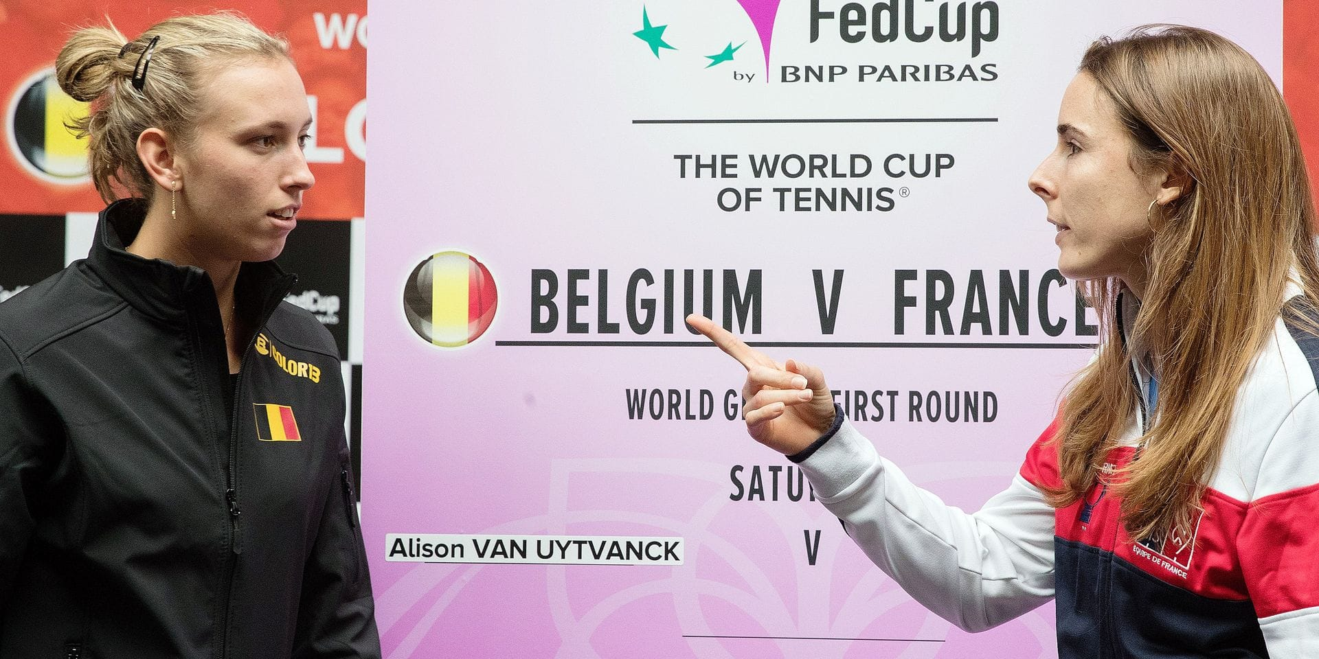 Belgian Elise Mertens and French Alize Cornet pose after the draw of the playing schedule for this weekend's quarter-final of the Fed Cup tennis meeting between Belgium and France, in the World Group, Friday 08 February 2019, in Liege. BELGA PHOTO BENOIT DOPPAGNE