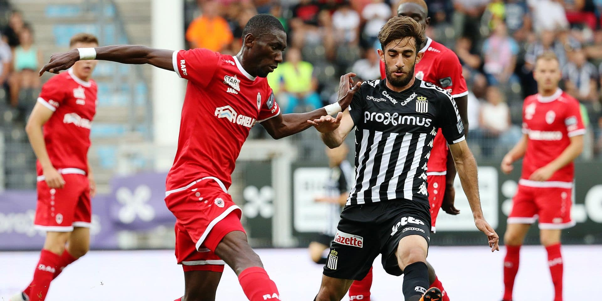 Antwerp's William Owusu Acheampong and Charleroi's Ali Gholizadeh fight for the ball during the Jupiler Pro League match between Sporting Charleroi and Royal Antwerp FC, in Charleroi, Sunday 29 July 2018, on the first day of the Jupiler Pro League, the Belgian soccer championship season 2018-2019. BELGA PHOTO VIRGINIE LEFOUR