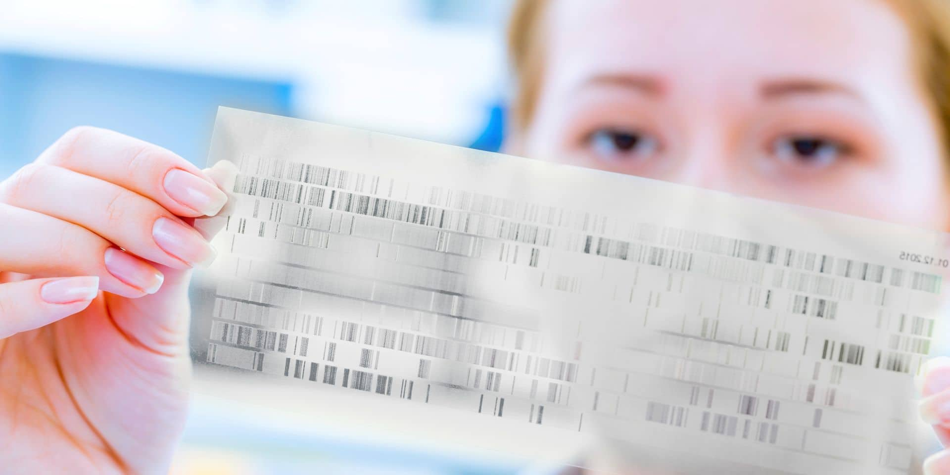 Scientist holding dna sequencing results