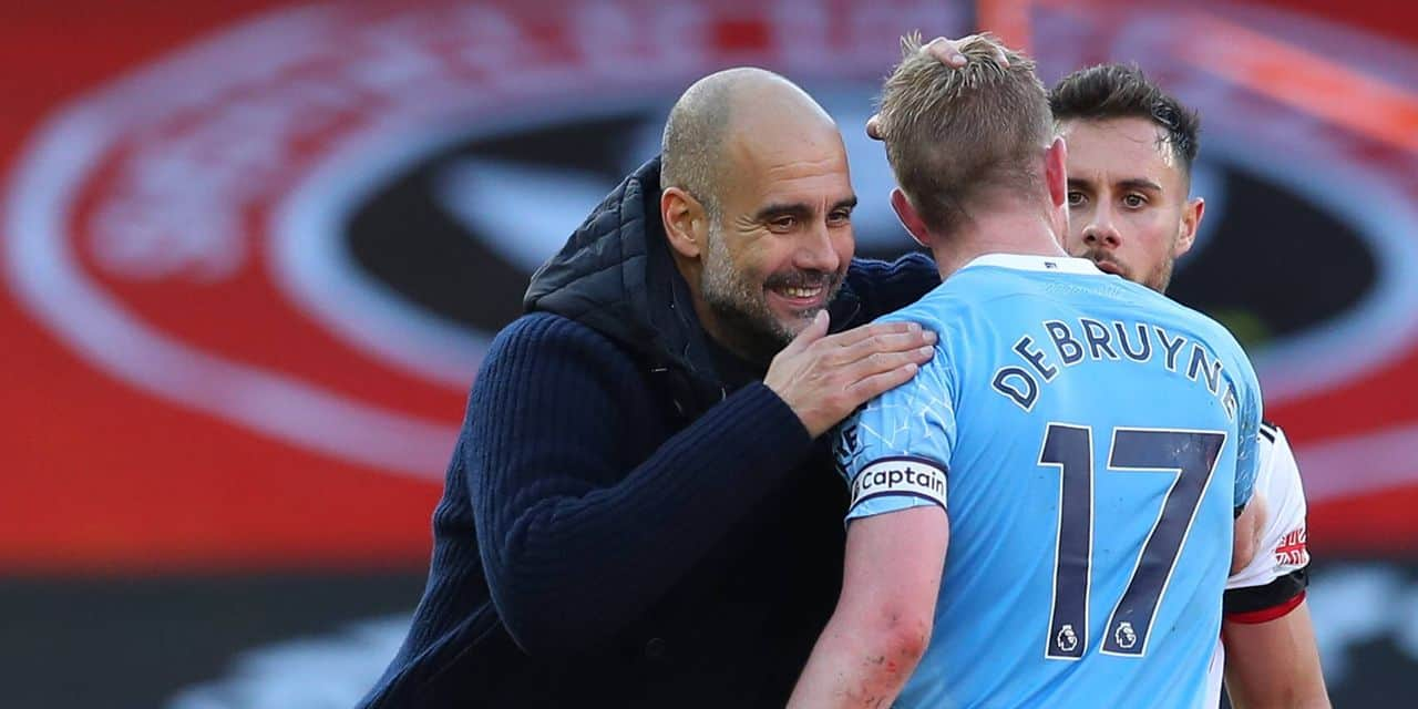 Josep Guardiola manager of Manchester City congratulates Kevin De Bruyne of Manchester City after the win during the Pre