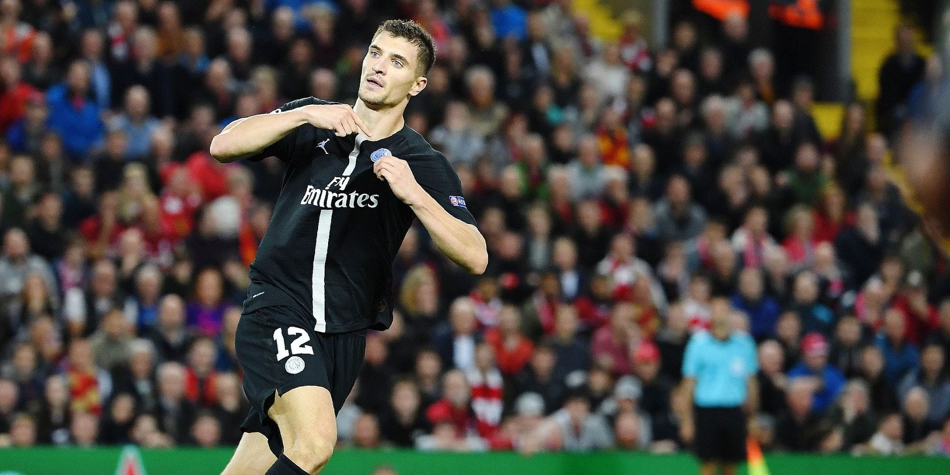 Paris Saint-Germain's Belgian defender Thomas Meunier celebrates scoring the team's first goal during the UEFA Champions League group C football match between Liverpool and Paris Saint-Germain at Anfield in Liverpool, north west England on September 18, 2018. (Photo by Paul ELLIS / AFP)