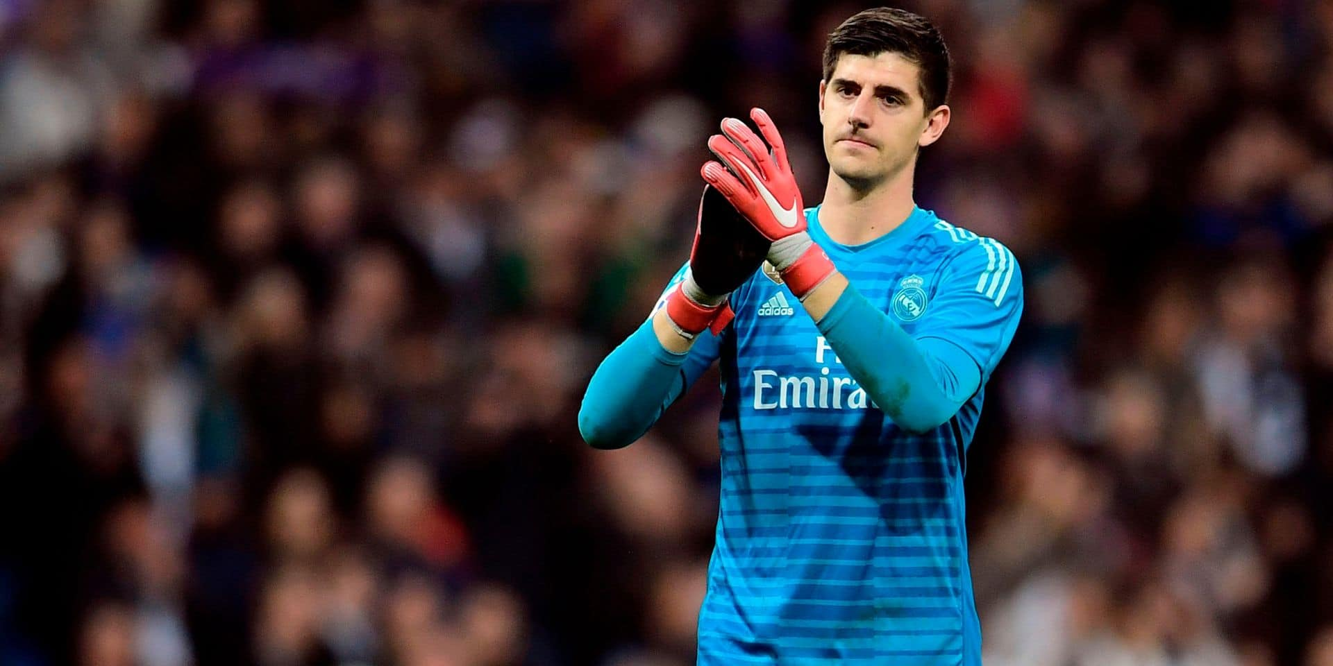 Real Madrid's Belgian goalkeeper Thibaut Courtois celebrates at the end of the Spanish league football match between Real Madrid CF and Real Valladolid FC at the Santiago Bernabeu stadium in Madrid on November 3, 2018. (Photo by JAVIER SORIANO / AFP)