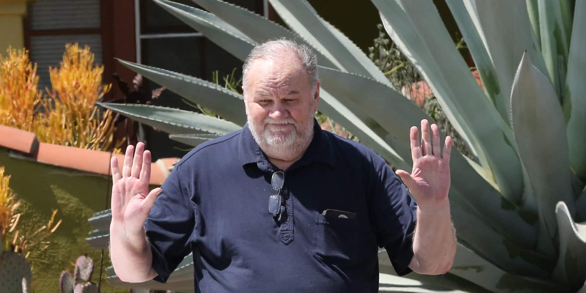 Meghan Markle's father thomas markle drops off flowers at her Meghan's mother Doria ragland home days before the wedding