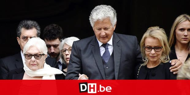 (From L) French actress and singer Line Renaud, son of late French radio and tv host, producer, writer and journalist Pierre Bellemare, Pierre Dhostel and his wife Carole, leave the Saint-Roch church in Paris, on May 31, 2018, after the funeral ceremony of Pierre Bellemare. A portrait of late French radio and tv host, producer, writer and journalist Pierre Bellemare is seen inside the Saint-Roch church in Paris, on May 31, 2018, during his funeral ceremony. Bellemare died on May 26, 2018, at the age of 88. / AFP PHOTO / Bertrand GUAY